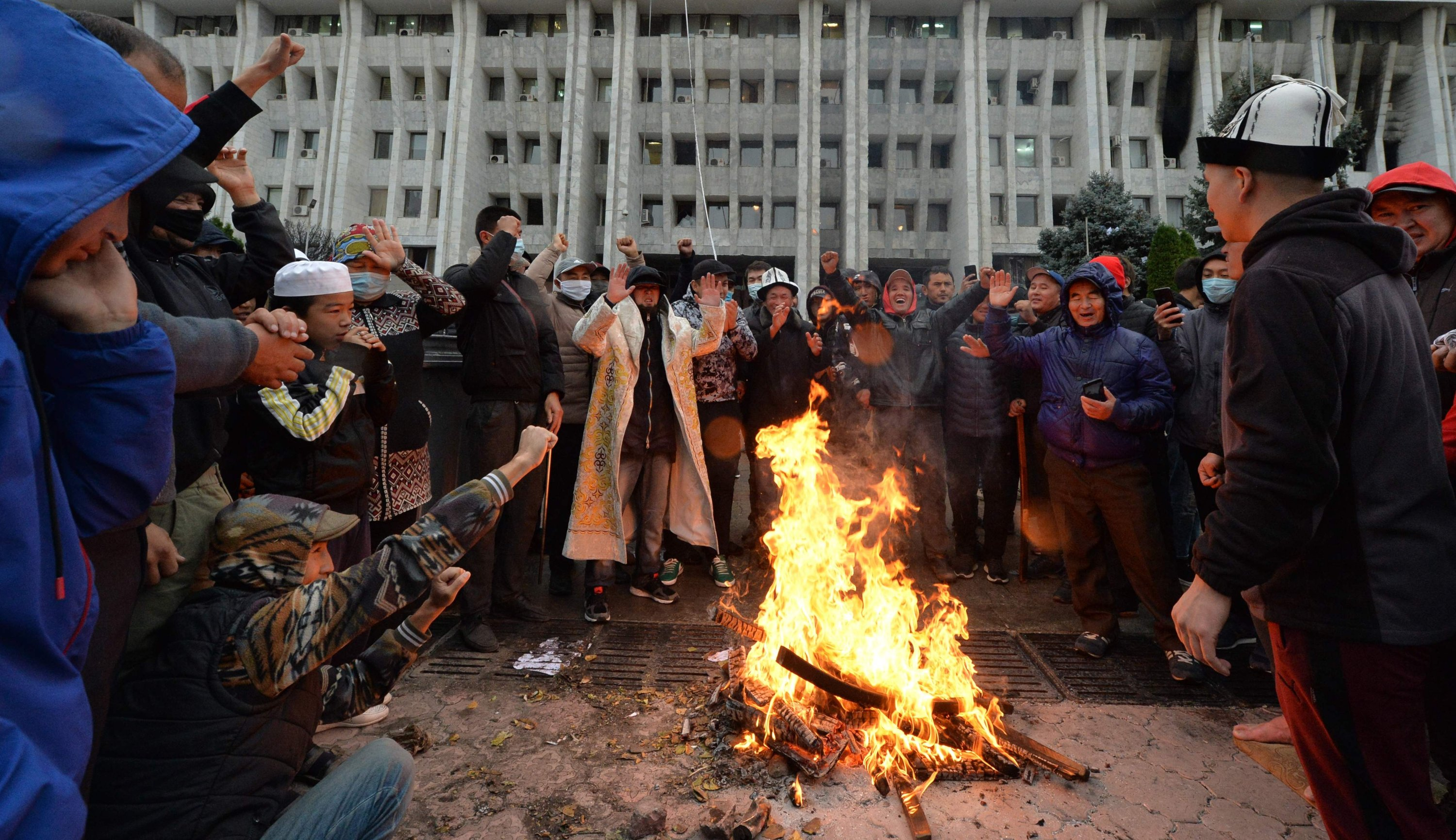 People protesting the results of a parliamentary vote gather by a bonfire in front of the seized main government building, known as the White House, in Bishkek, on Oct. 6, 2020. (AFP Photo)