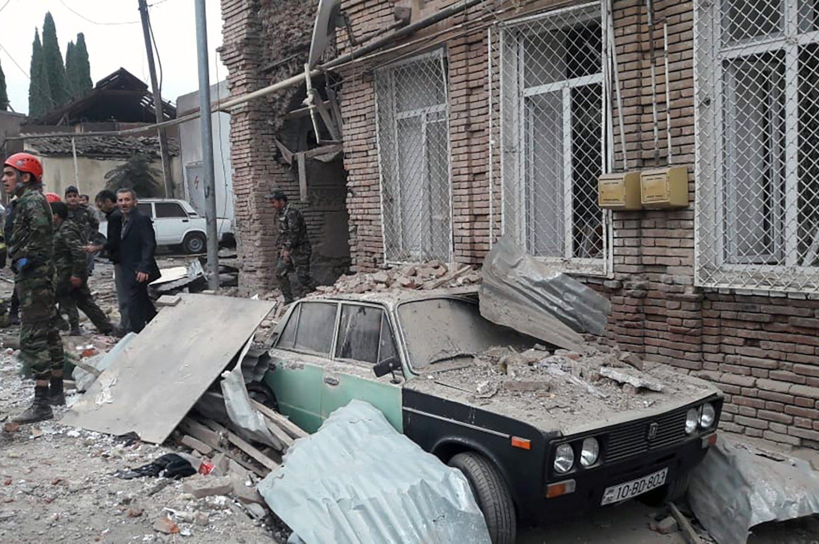 Emergency personnel work at the site of an Armenian rocket strike in Ganja, Azerbaijan, Oct. 4, 2020. (Azerbaijani Presidency/AFP)
