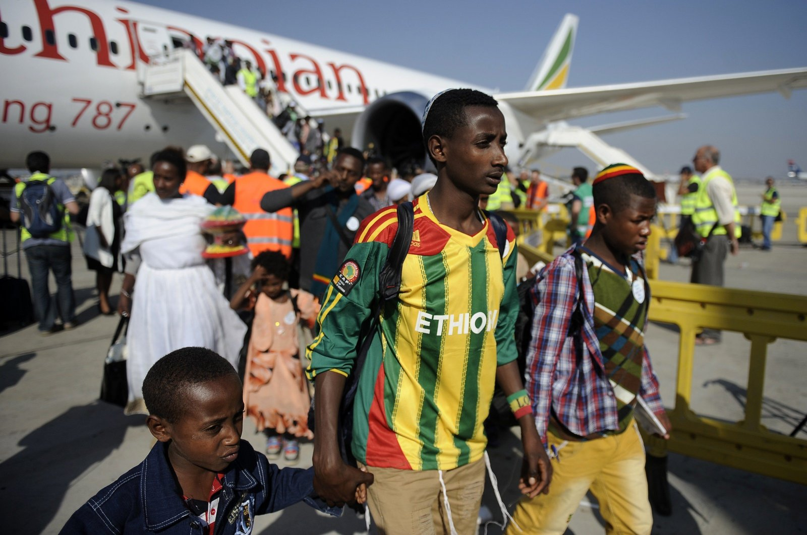 Newly-arrived Jewish immigrants coming from Ethiopia step off the plane upon their arrival at Ben Gurion International Airport on Aug. 28, 2013 near the Israeli costal city of Tel Aviv. (AFP Photo)