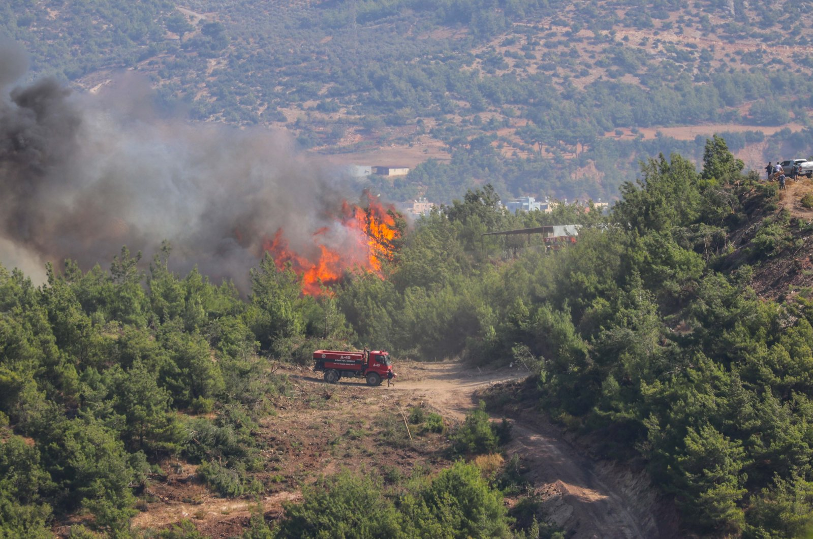 The fires that began Friday in several parts of Belen district continue to burn on Saturday, Belen, Turkey, Oct. 9, 2020. (Anadolu Agency)