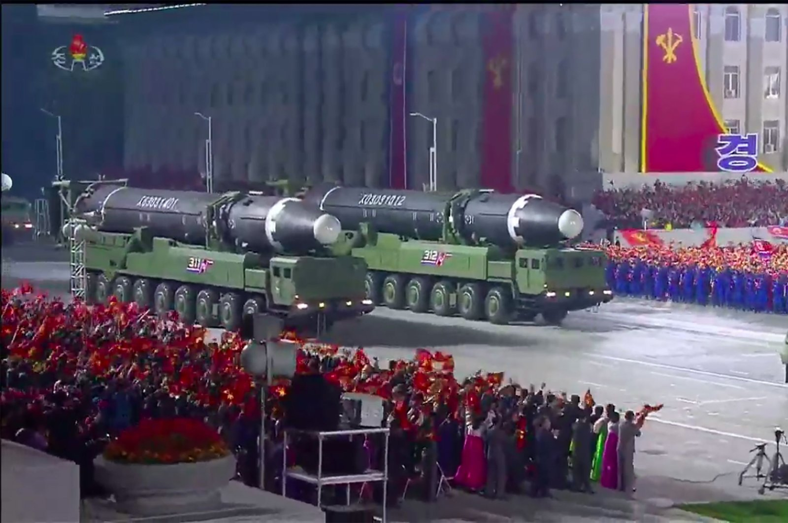 A screen grab taken from a KCNA broadcast shows what appears to be new North Korean intercontinental ballistic missiles during a military parade marking the 75th anniversary of the founding of the Workers' Party of Korea, on Kim Il Sung square in Pyongyang, Oct. 10, 2020  (Photo by - / KCNA VIA KNS / AFP)