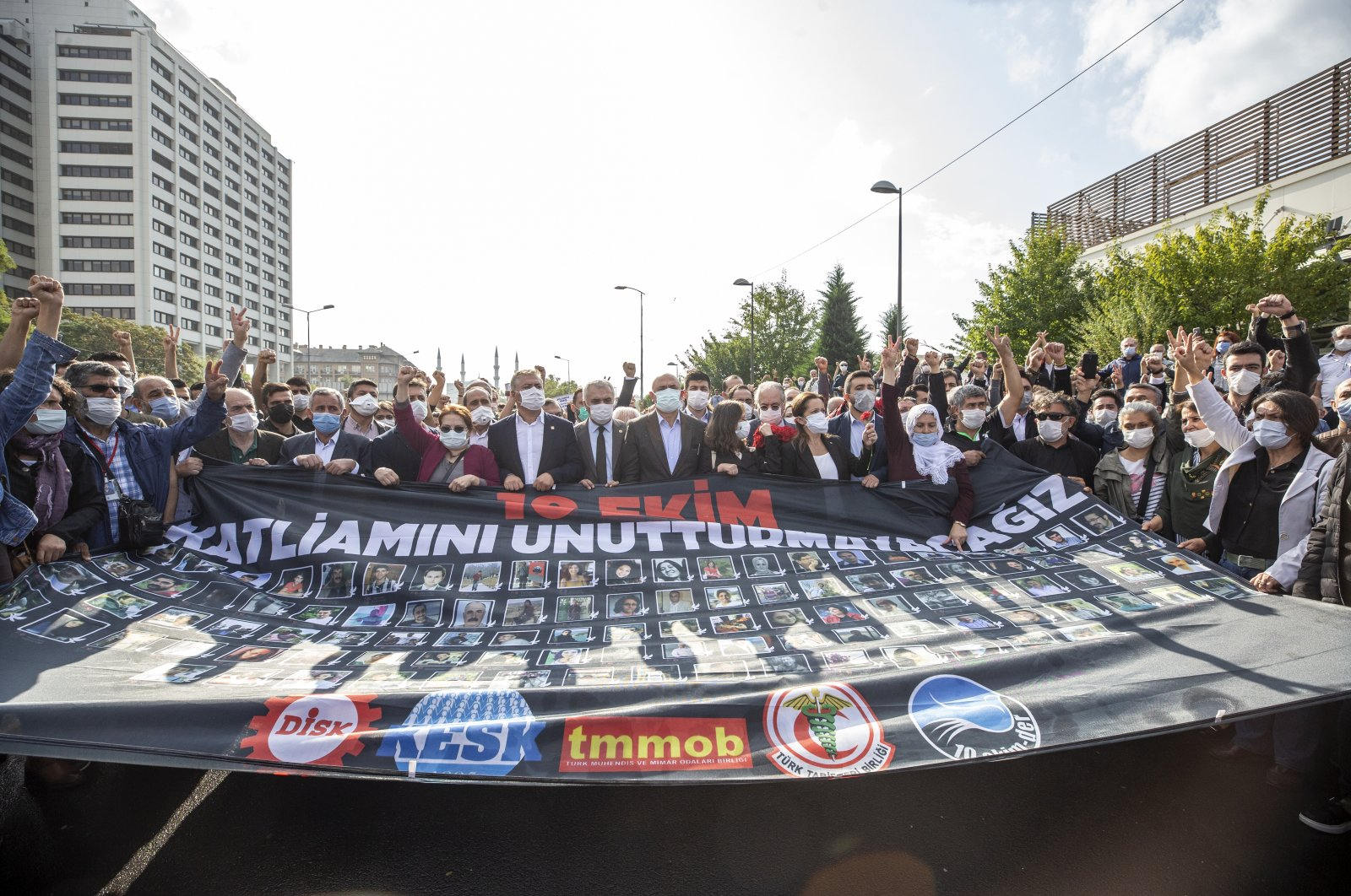 A group holds a banner showing the victims of the 2015 suicide attacks during a commemoration ceremony in the capital Ankara, on Oct. 10, 2020. (AA Photo)