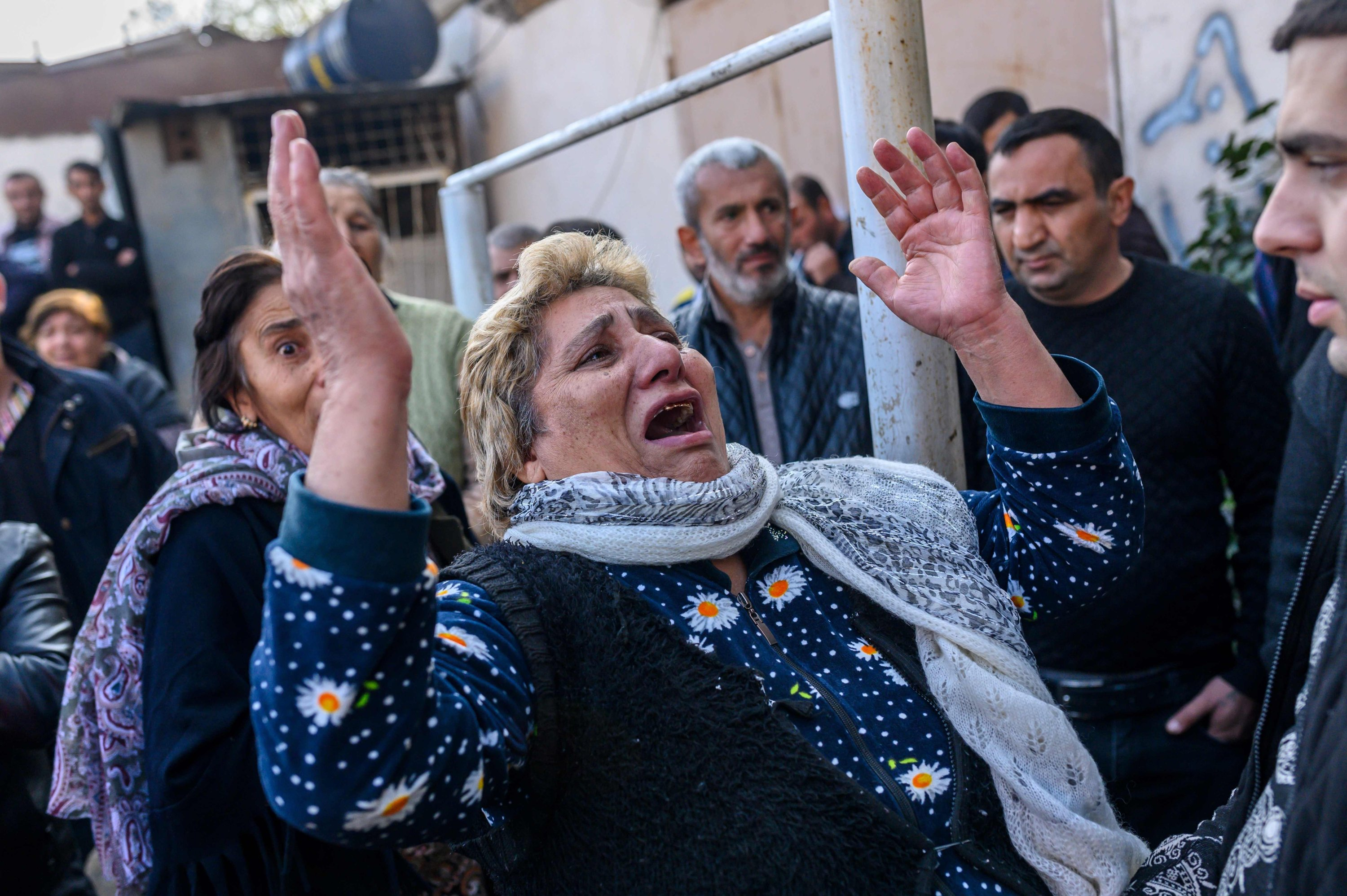 Azerbaijani women react as rescuers search for victims or survivors at the blast site hit by an Armenian rocket in the city of Ganja, Azerbaijan, Oct. 11, 2020. (AFP)