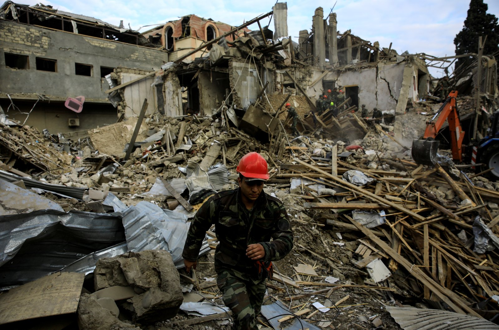 Search and rescue teams work on the blast site hit by a rocket during the fighting in the city of Ganja, Azerbaijan Oct. 11, 2020. (Reuters Photo)