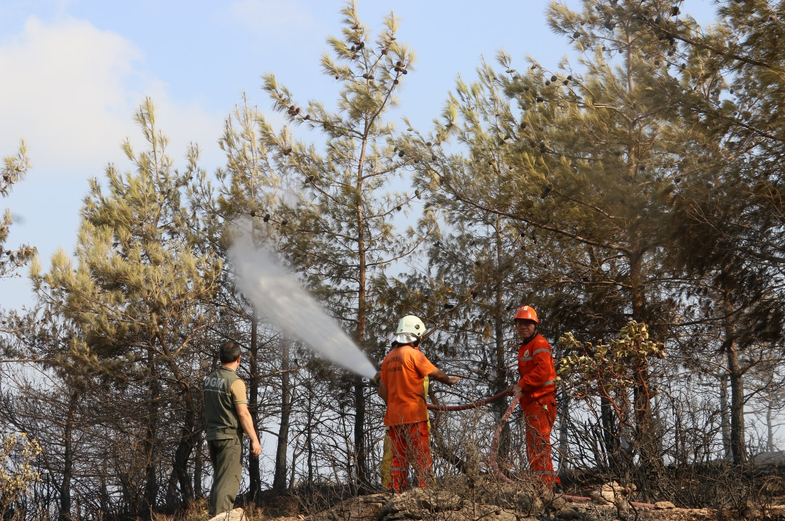 A Turkish fire squad cools down the fire perpetrated by the PKK terrorist group in southern Hatay province's Belen district on Oct. 11, 2020. (AA Photo)