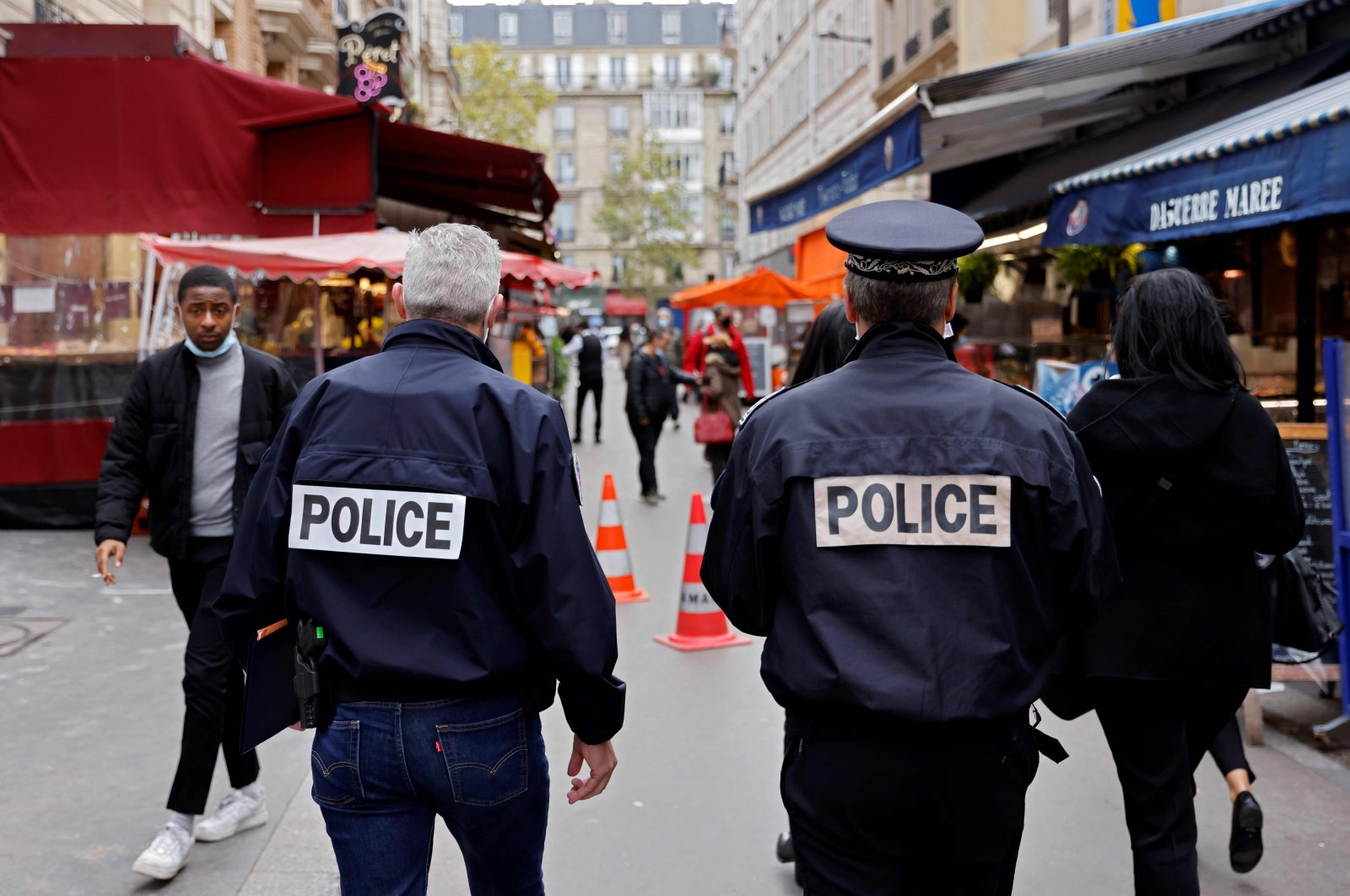 Police officers walk in a street with restaurants, Paris, Oct. 6, 2020. (AFP Photo)