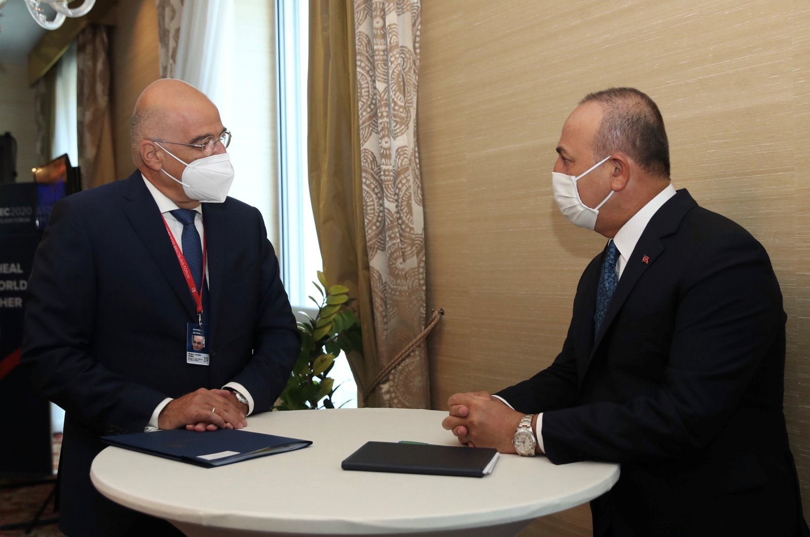 Foreign Minister Mevlüt Çavuşoğlu speaks with his Greek counterpart Nikos Dendias on the sidelines of the Global Security Forum in Bratislava, Slovakia, Oct. 8, 2020. (Turkish Foreign Ministry handout)