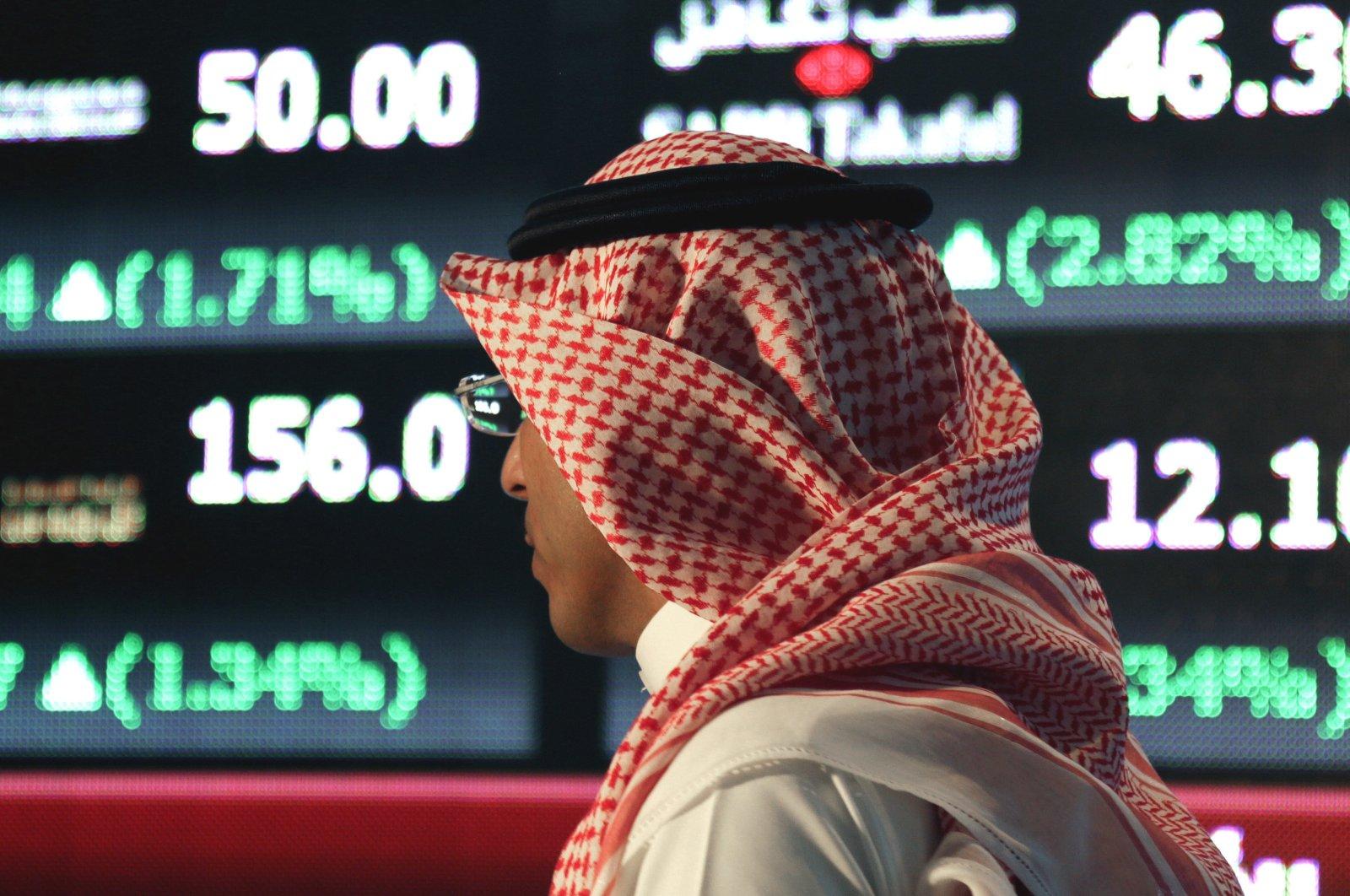 A Saudi man walks through the Tadawul stock exchange in Riyadh, Saudi Arabia on June 15, 2015. (AP Photo)