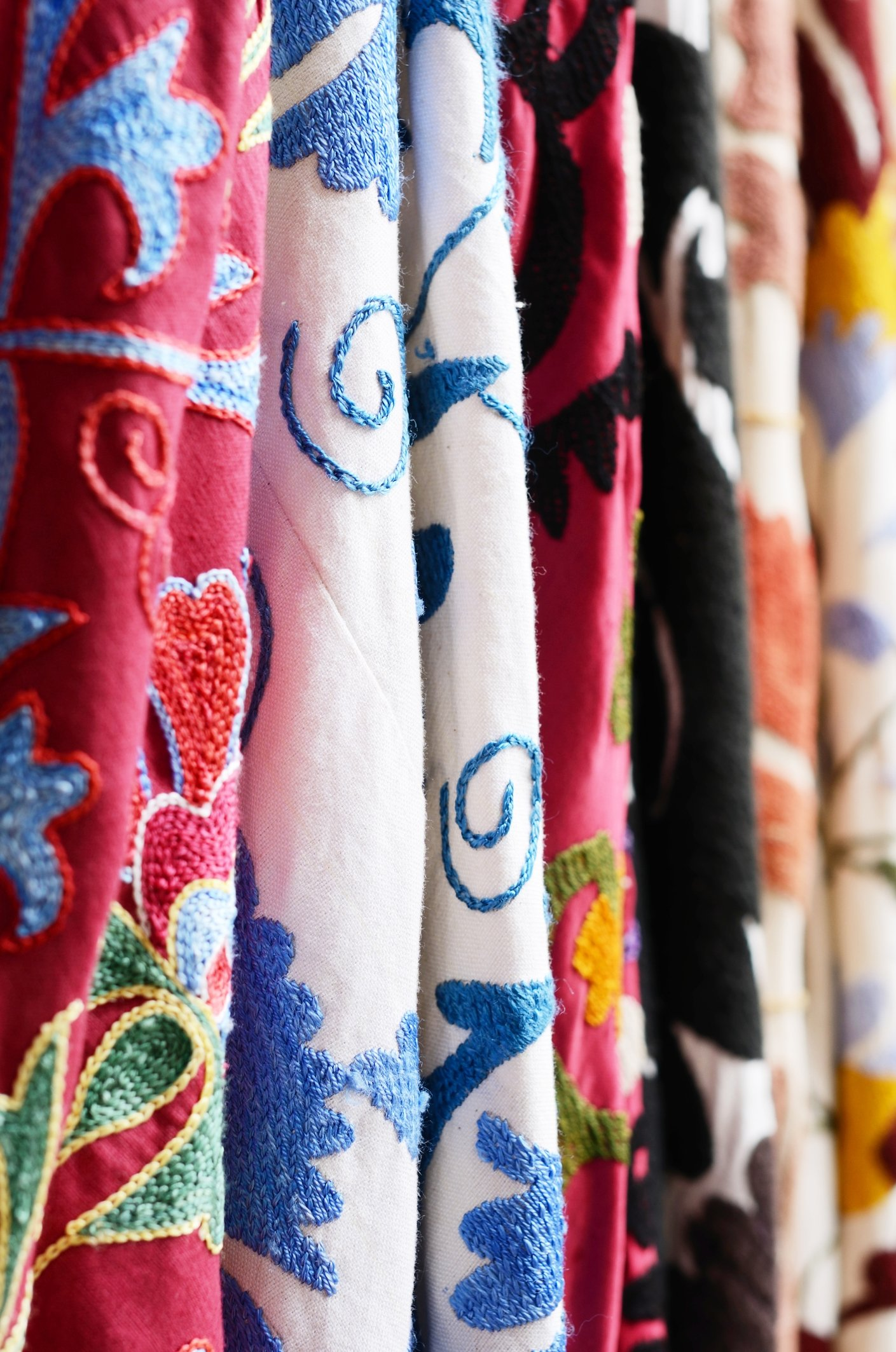 Traditional suzani embroidered fabrics hanging at a bazaar. (iStock Photo)