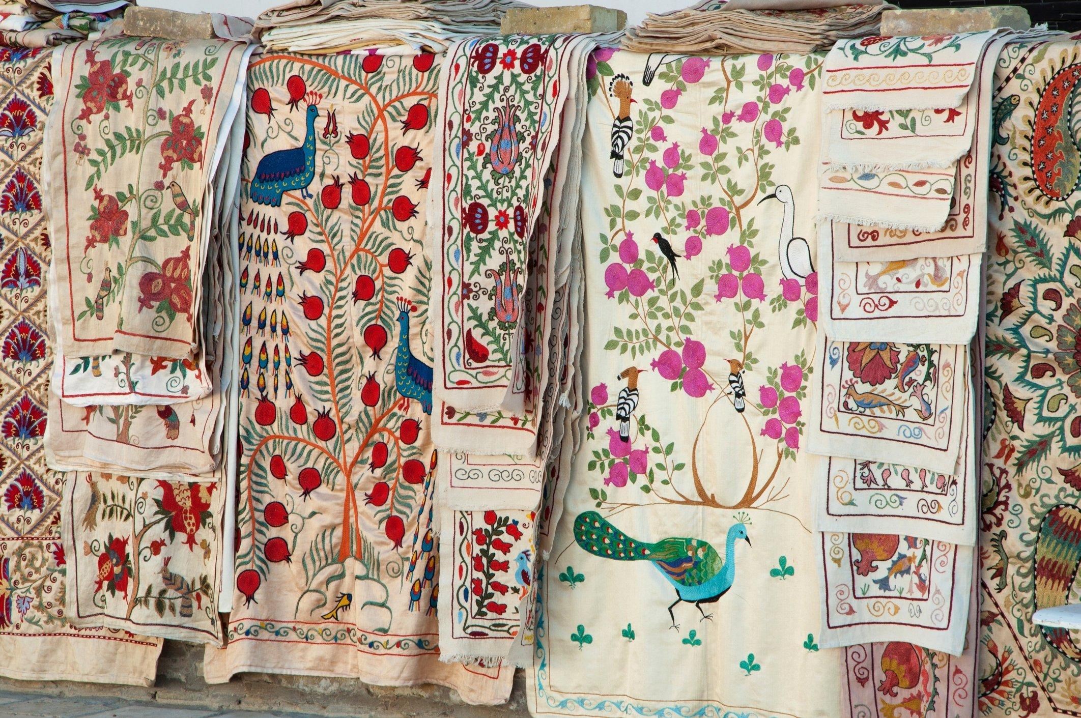 Market stalls lined with traditional Uzbek suzani fabrics. (iStock Photo)