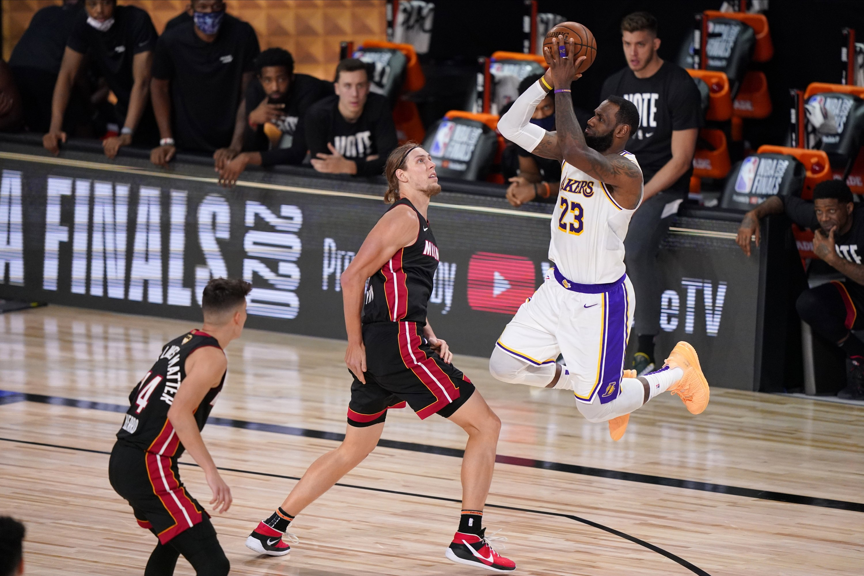 Los Angeles Lakers' LeBron James takes a shot over Miami Heat's Kelly Olynyk during the Game 6 of NBA Finals, in Lake Buena Vista, Florida, U.S., Oct. 11, 2020. (AP Photo)