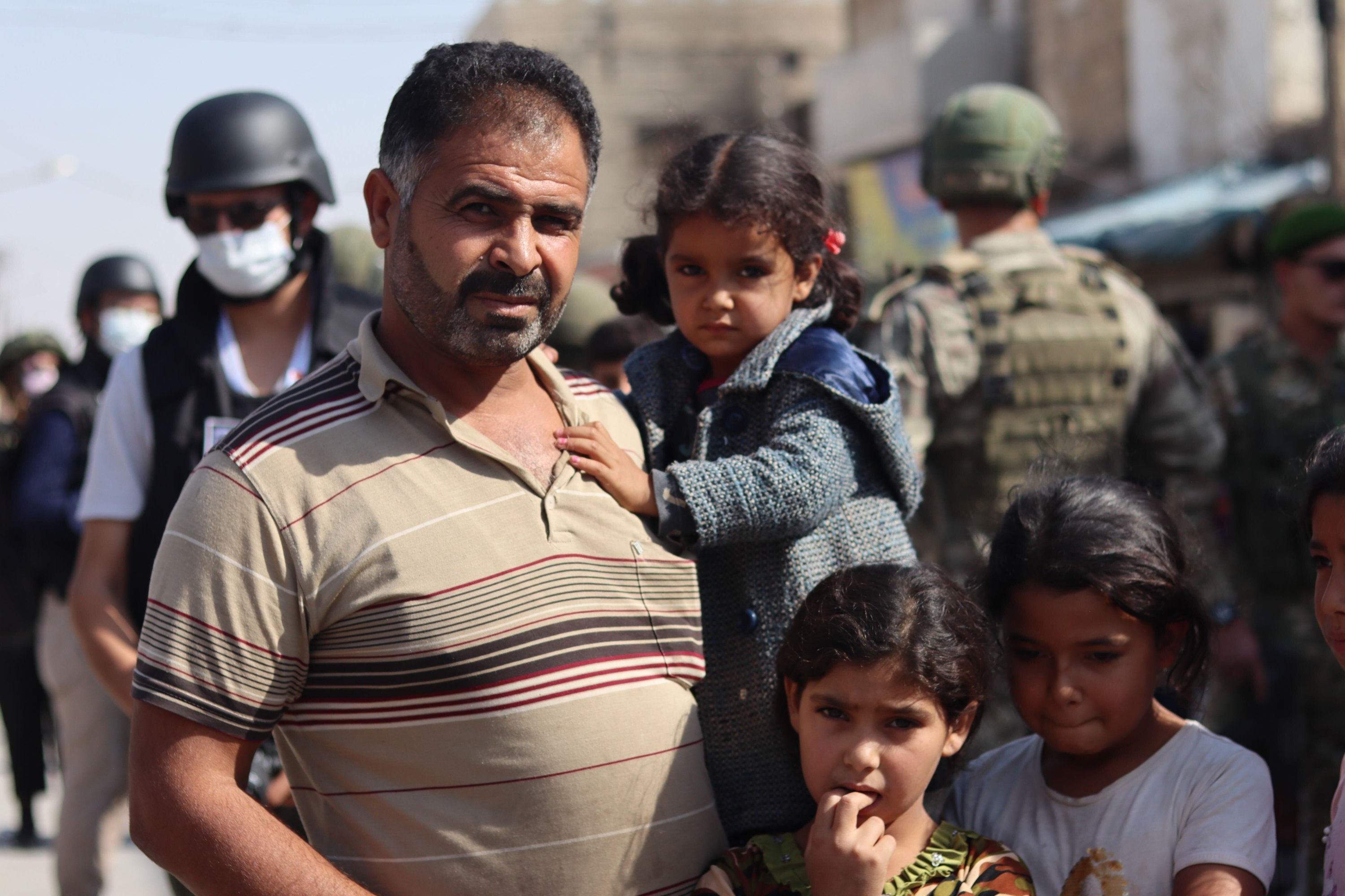 A man, with his four daughters, explains he is trying to get by and look after his children while his wife is in treatment in Turkey's Şanlıurfa province, Oct. 11, 2020. (Dilara Aslan)