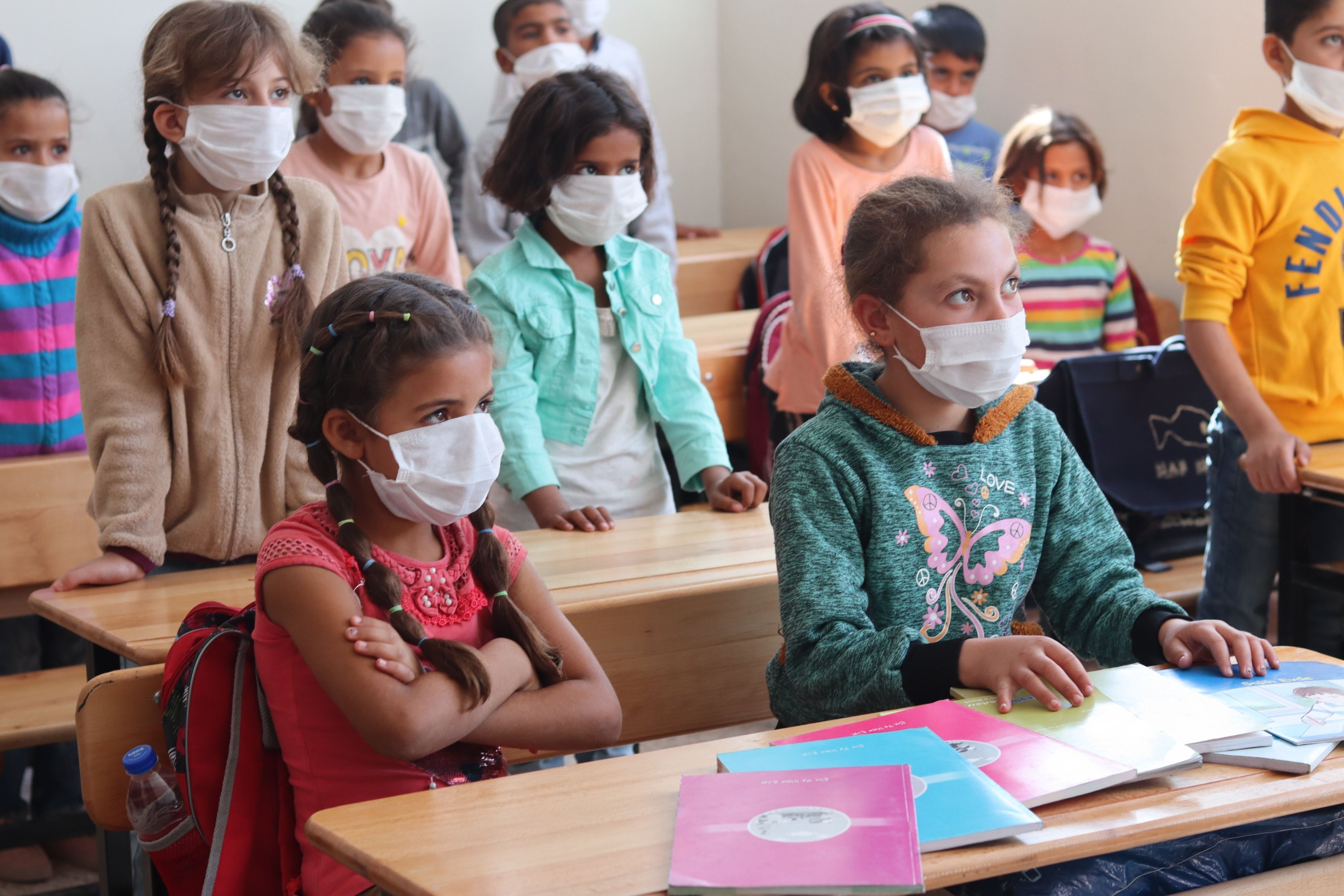 Children, who have recently begun to receive their education under COVID-19 measures, are seen in one of the classrooms of Tal Abyad's Ahmet Yasin Primary School, Oct. 11, 2020. (Dilara Aslan)