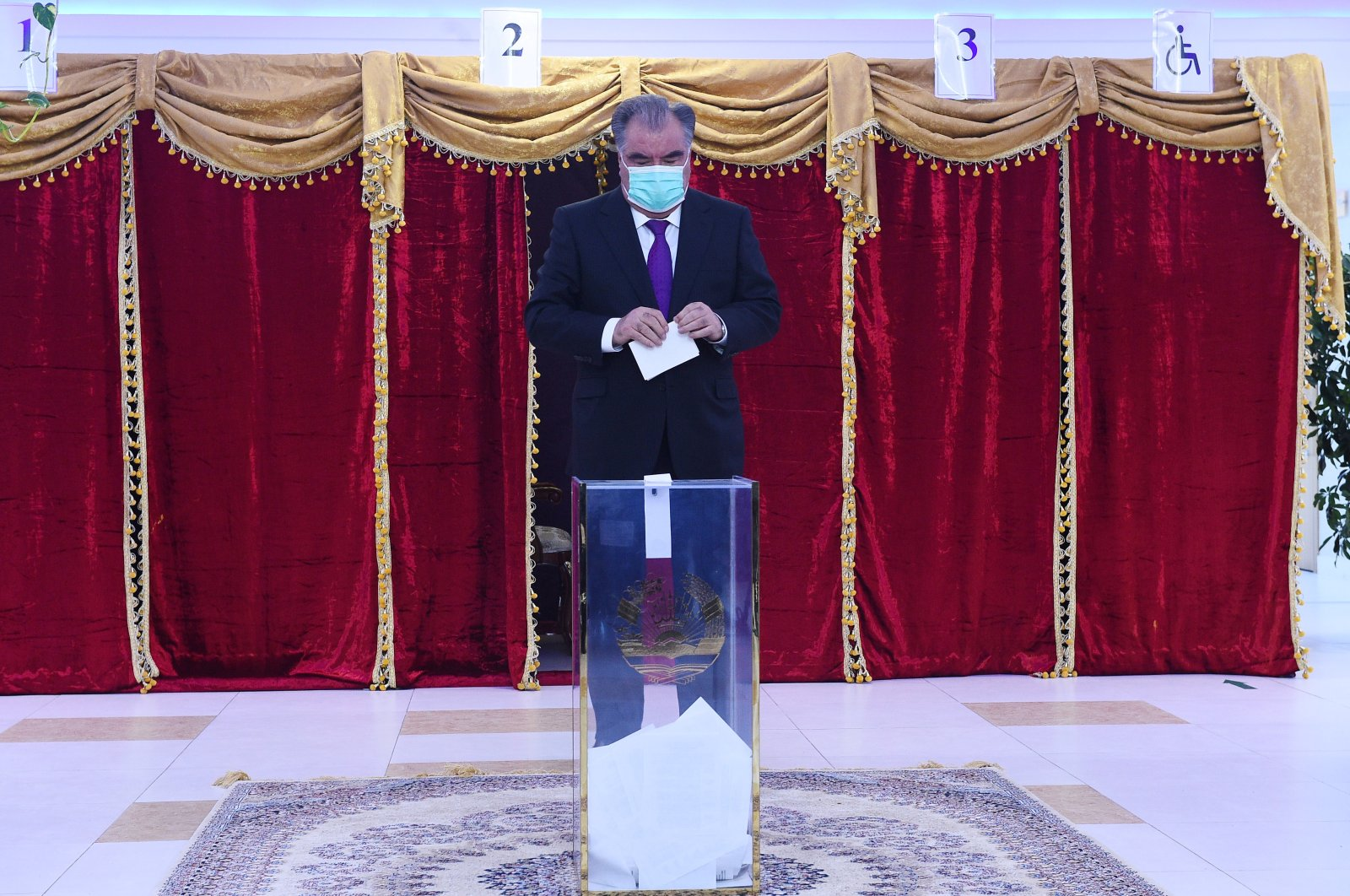 Tajikistan's President and Presidential candidate Emomali Rakhmon casts his ballot at a polling station during the presidential election in Dushanbe, Tajikistan, Oct. 11, 2020. (Press service of the President of Tajikistan/Reuters)