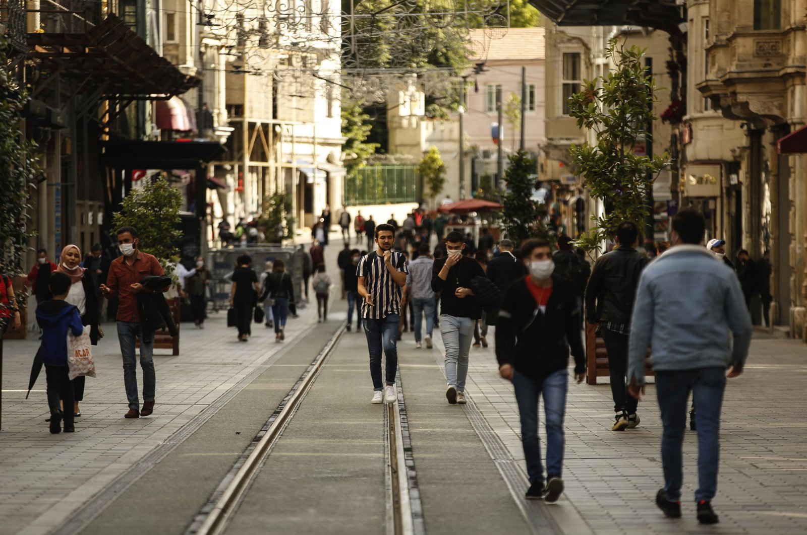 People, most wearing protective face masks against the spread of coronavirus, walk on Istiklal street, in one of Istanbul's main shopping districts, June 1, 2020. (AP Photo)
