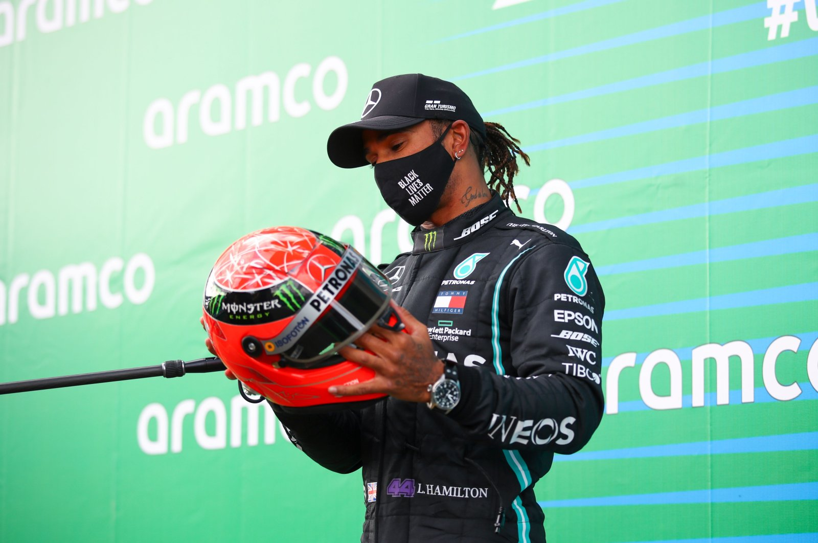 Lewis Hamilton holds the helmet of Michael Schumacher that was gifted to him, after winning the German F1 Grand Prix, in Nurburg, Germany, Oct. 11, 2020. (AFP Photo)