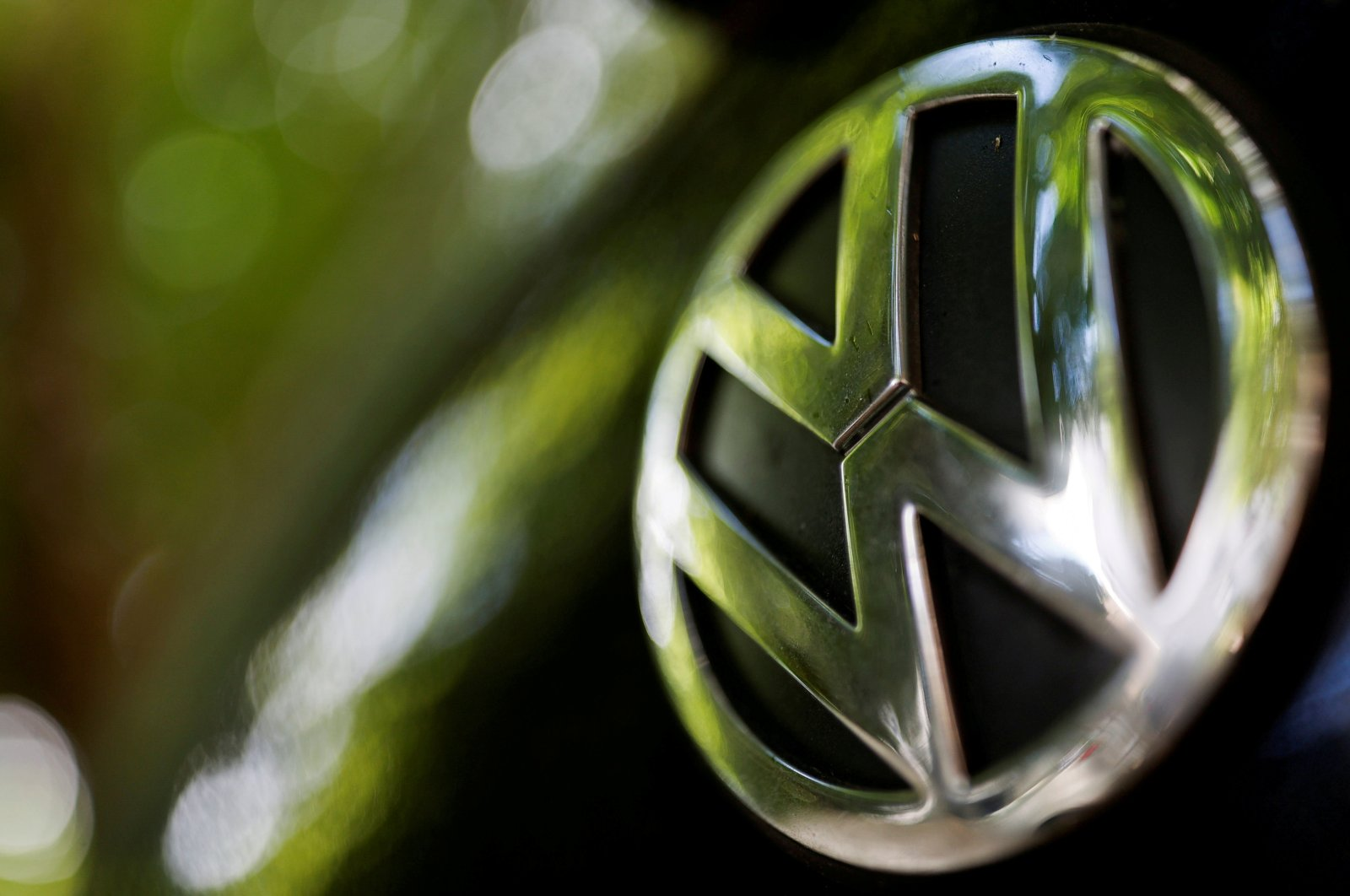A logo of German carmaker Volkswagen is seen on a car parked on a street in Paris, France, July 9, 2020. (Reuters Photo)