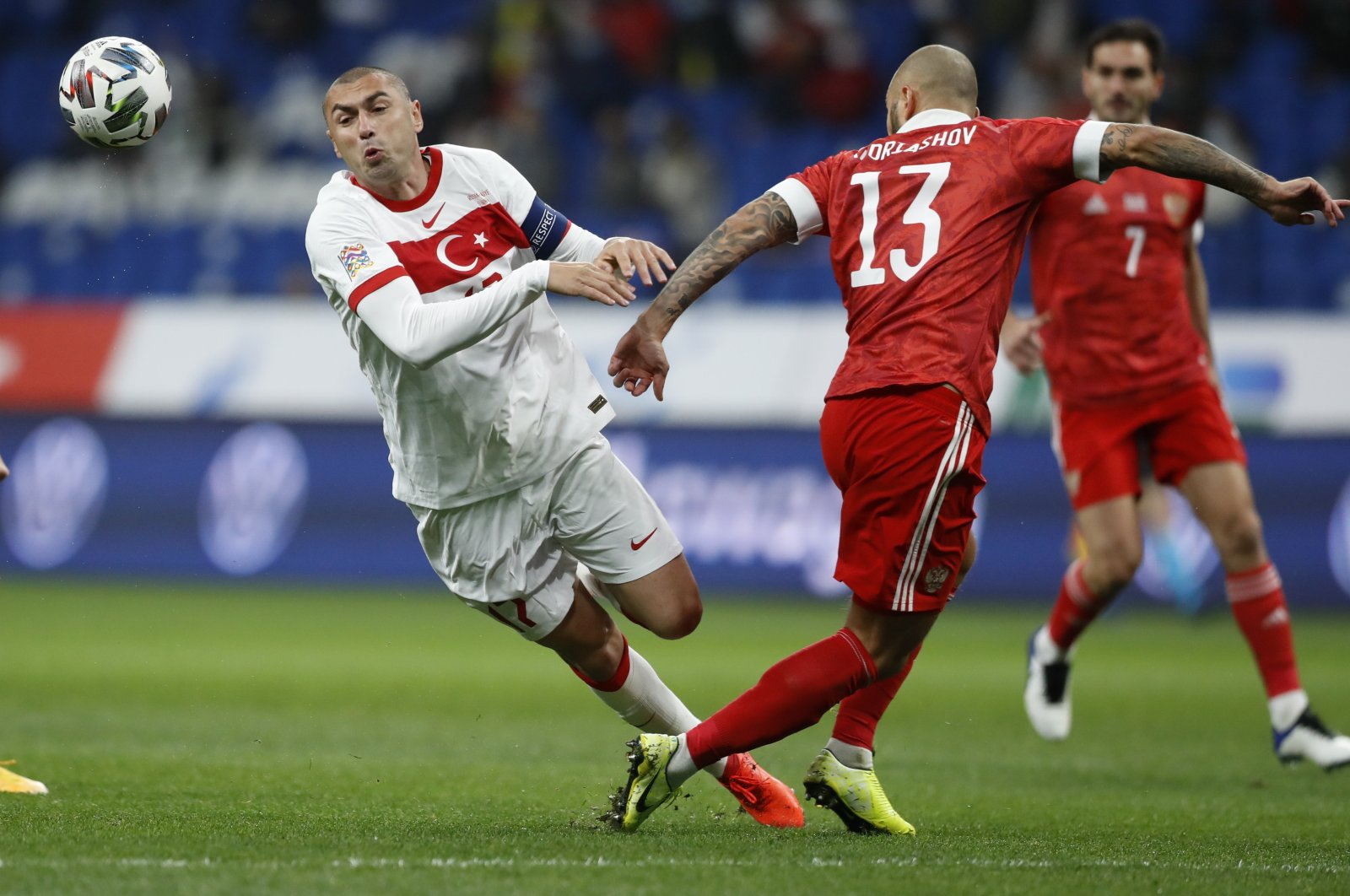 Turkey's Burak Yımaz (L) and Russia's Fyodor Kudryashov battle for the ball during a UEFA Nations League match in Moscow, Russia, Oct. 11, 2020. (AP Photo)