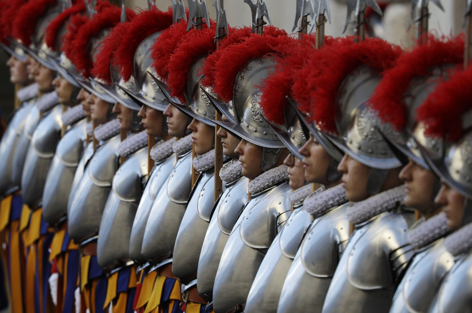 Vatican Swiss Guards stand attention at the St. Damaso courtyard on the occasion of their swearing-in ceremony, at the Vatican, Oct. 4, 2020. (AP Photo)