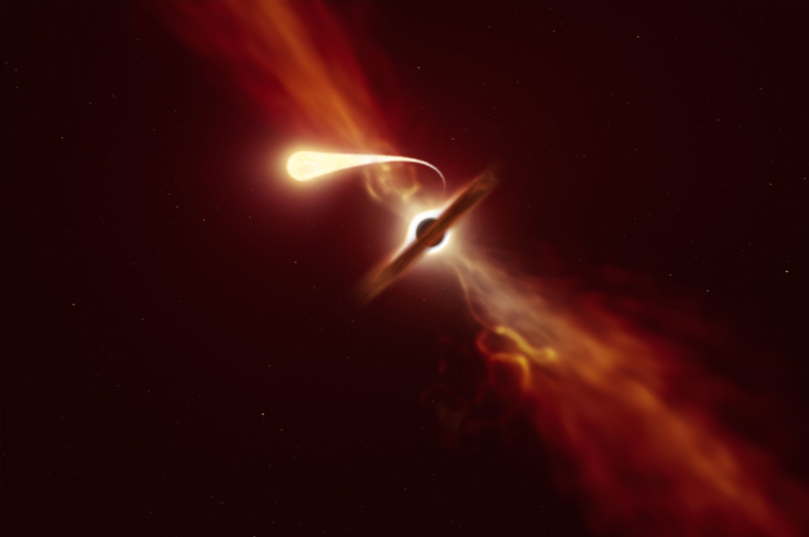"""An illustration depicts a star (in the foreground) experiencing """"spaghettification"""" as it is sucked in by a supermassive black hole (in the background) during a """"tidal disruption event,"""" released Oct. 12, 2020. (Photo by M. Kornmesser / European Southern Observatory / AFP)"""