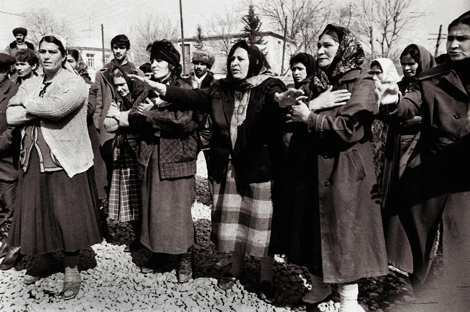 An archive photo shows people grieving for the massacre of ethnic Azerbaijanis by Armenians in the town of Khojaly, Nagorno-Karabakh, Azerbaijan, February 1992. (AA Photo)