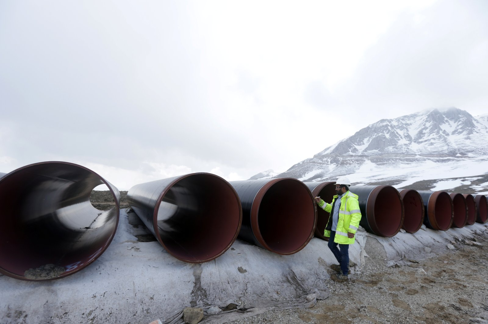 A local employee marks pipes at the nearby Marta Pass, the highest point of the Trans Adriatic Pipeline (TAP) in Korce, Albania, April 17, 2019. (Reuters Photo)
