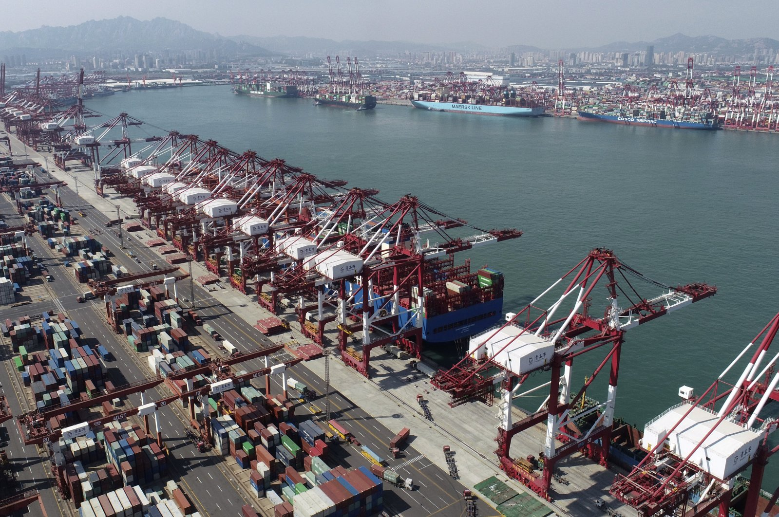 Container ships are docked at a container port in Qingdao, Shandong Province, eastern China, Oct. 8, 2020. (AP Photo)