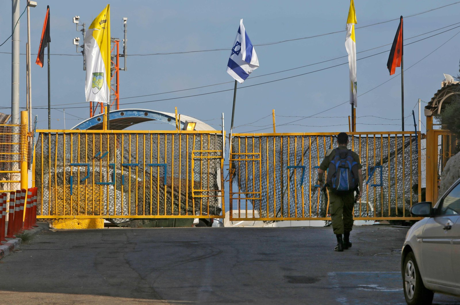 An Israeli soldier walking up to the gate of the Rosh HaNikra Crossing, also known as the Ras Al Naqoura Crossing, between Israel and Lebanon on Oct. 12, 2020. (AFP Photo)