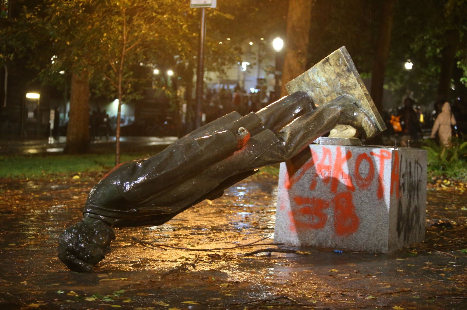 A group of protesters toppled statues of former Presidents Theodore Roosevelt and Abraham Lincoln in Portland's South Park Block, Oregon, U.S., Oct. 11, 2020. (AP Photo)