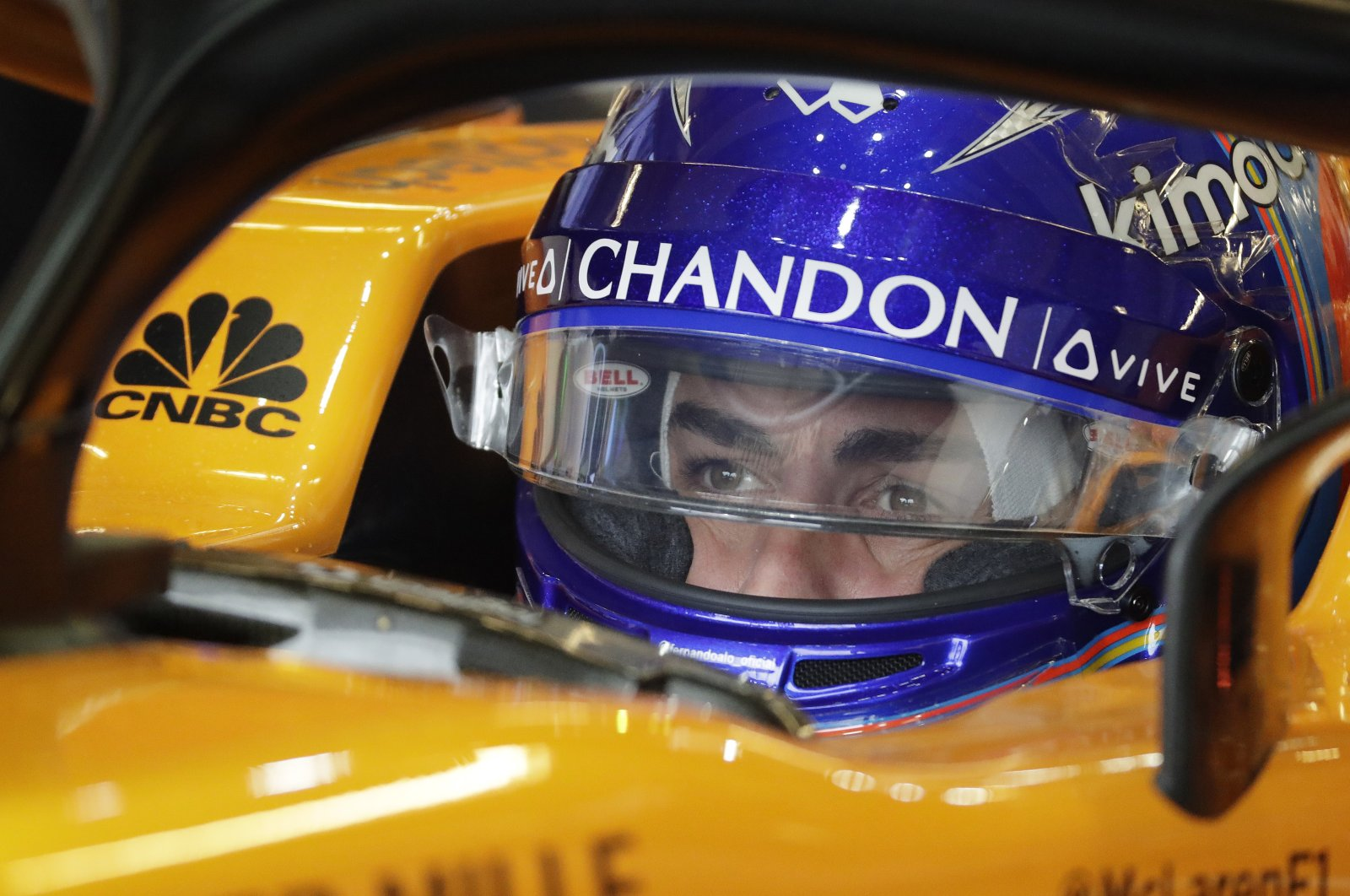 Fernando Alonso sits in his car during a Formula 1 practice session, in Austin, Texas, Oct. 19, 2018. (AP Photo)