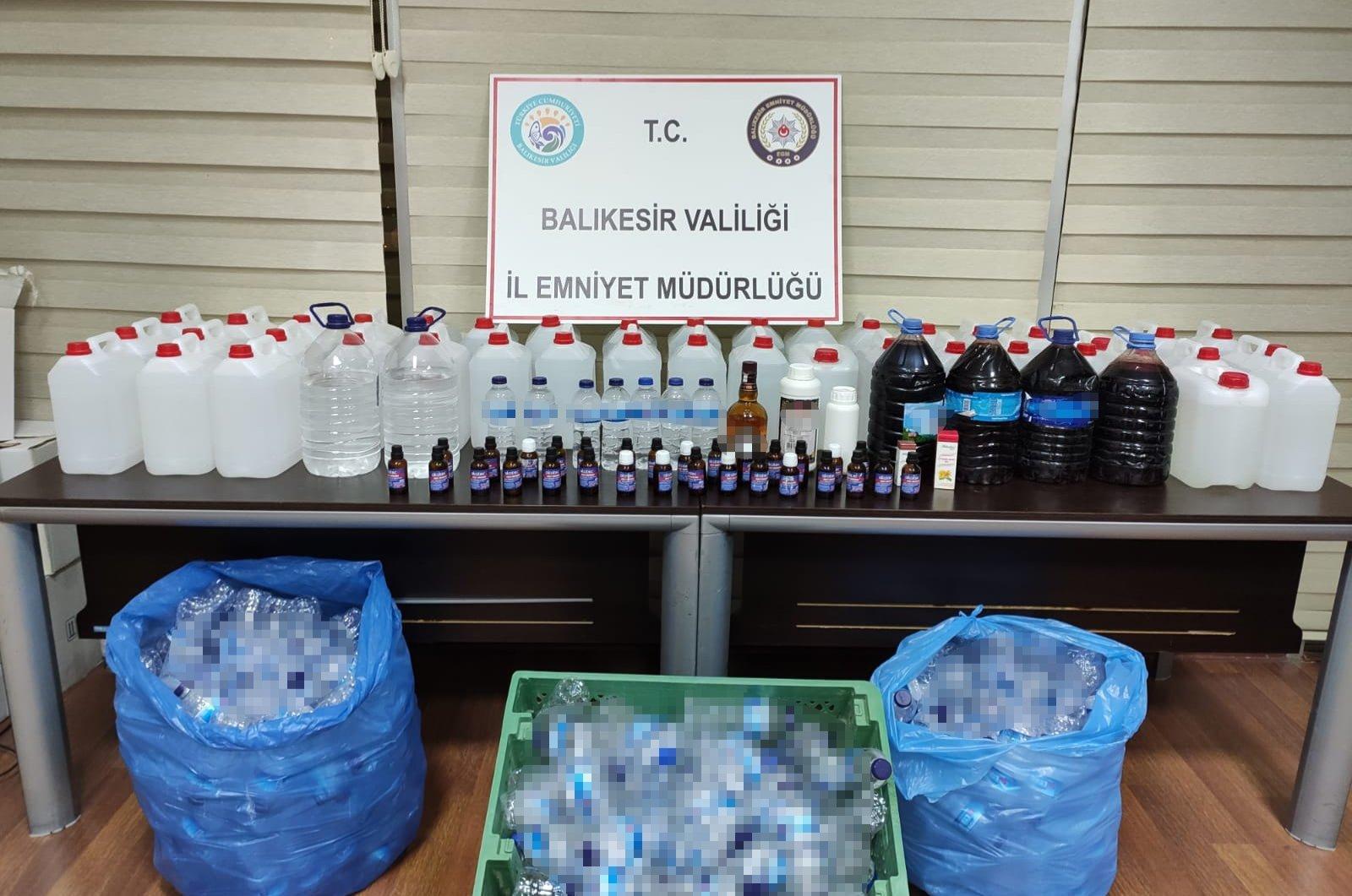 Police display bootleg alcohol seized in an operation in Balıkesir, western Turkey, Oct. 13, 2020. (AA Photo)