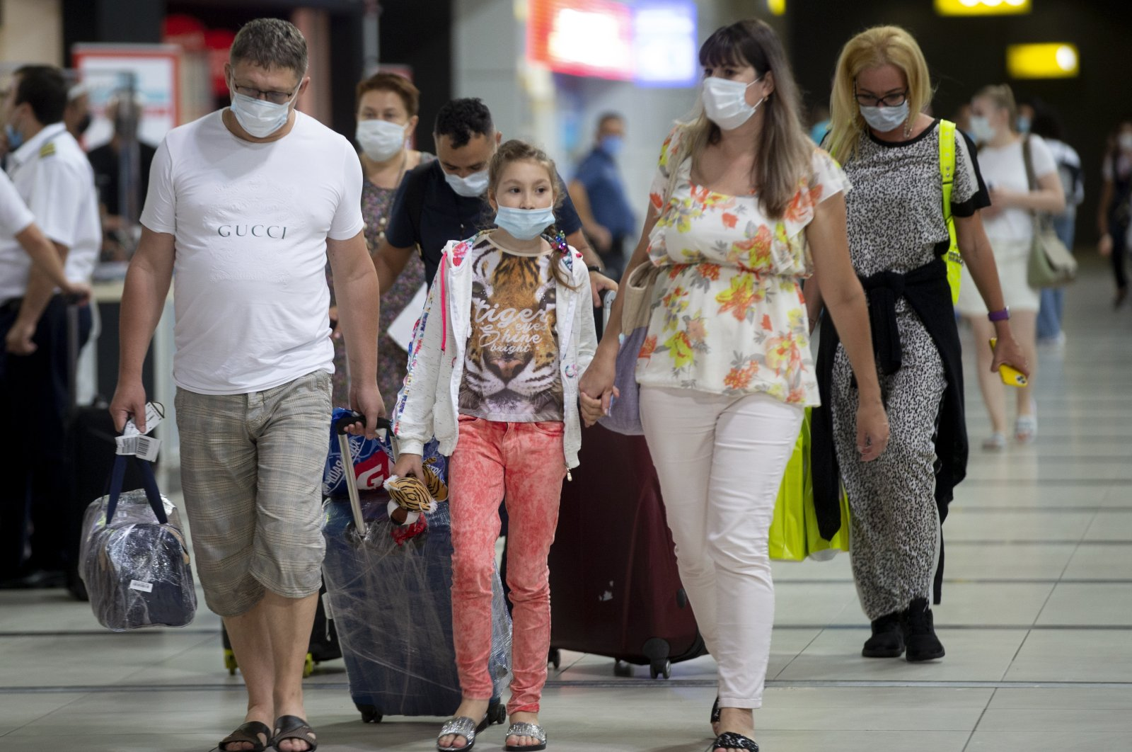 Russian tourists arrive at Antalya Airport in Antalya, southern Turkey, Aug. 16, 2020. (AA Photo)