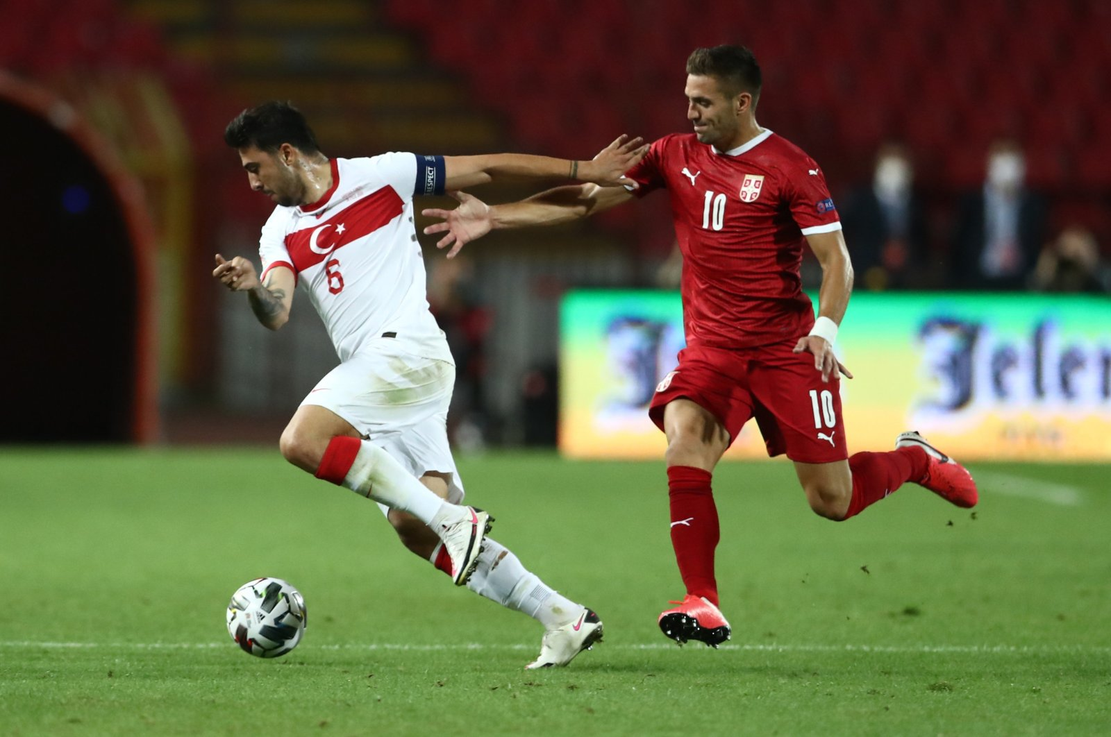 Turkey's Ozan Tufan dribbles past Serbia's Dusan Tadic during a UEFA Nations League match in Belgrade, Serbia, Sept. 6, 2020. (Reuters Photo)