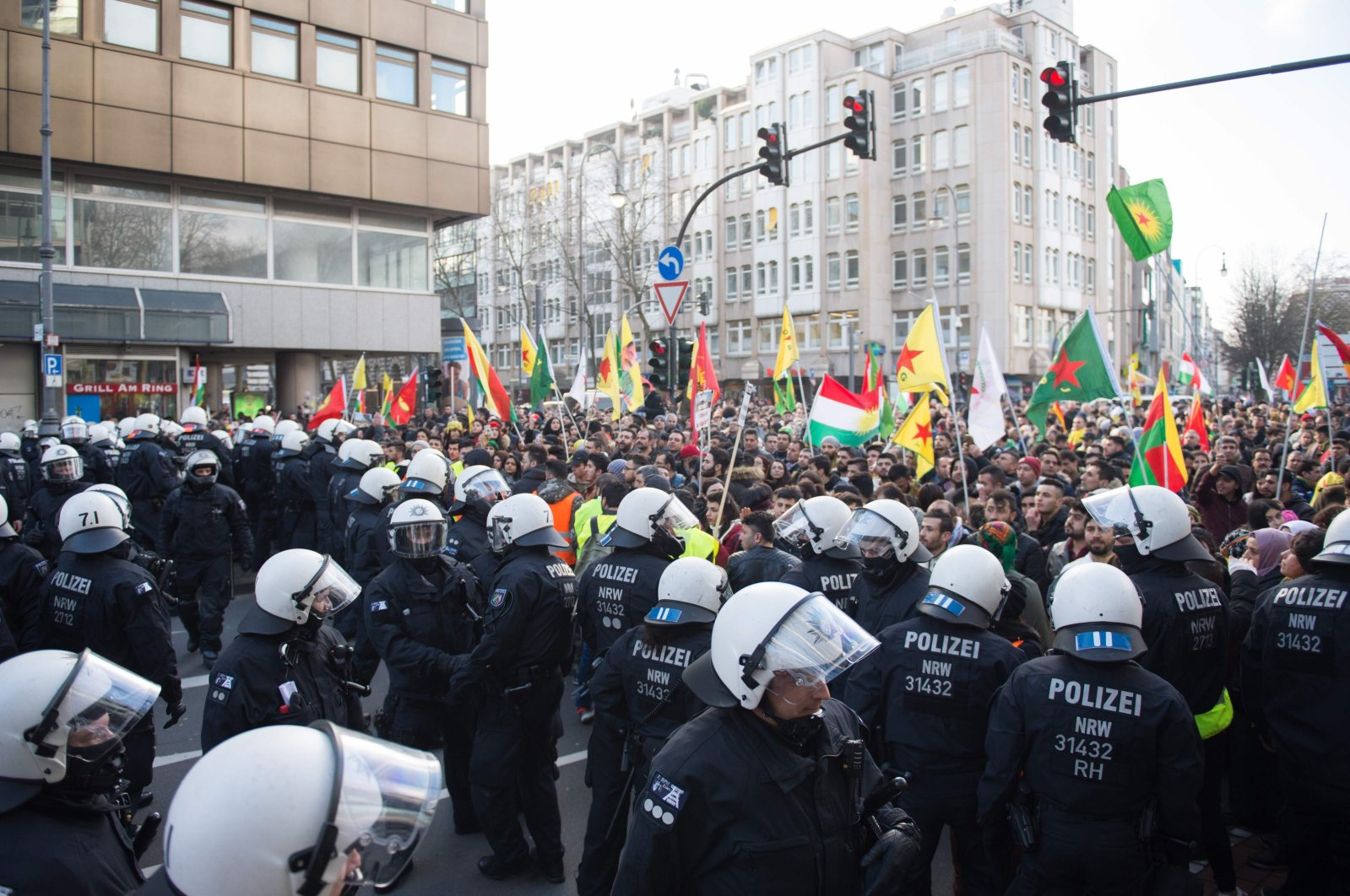 Police officers stop a mass PKK demonstration in Cologne with more than 20,000 participants in Cologne, Jan. 27, 2018.