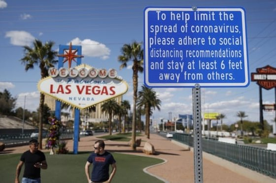 """A sign advises people to practice social distancing to slow the spread of the coronavirus at the """"Welcome to Fabulous Las Vegas Nevada"""" sign amid a shutdown of casinos along the Las Vegas Strip in Las Vegas, Nevada, U.S., March 21, 2020. (AP Photo)"""
