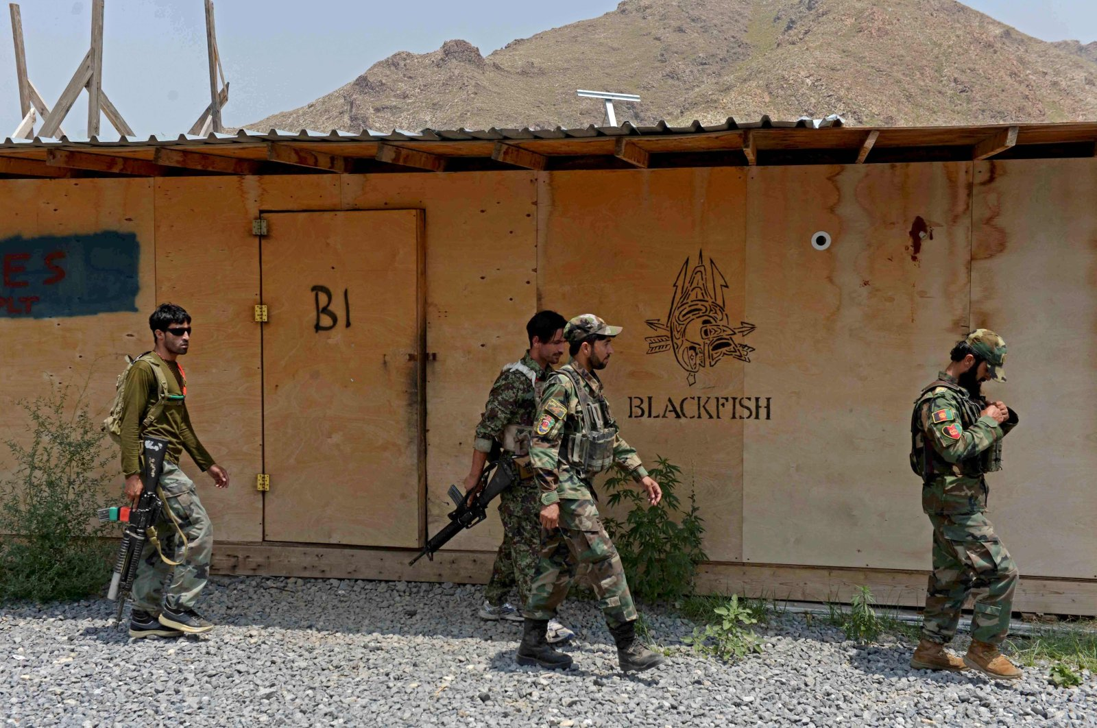 In this picture taken on July 26, 2020, Afghan National Army (ANA) soldiers walk in a U.S. military base, which has been recently handed over to Afghan forces in Achin district of Nangarhar province. (AFP Photo)