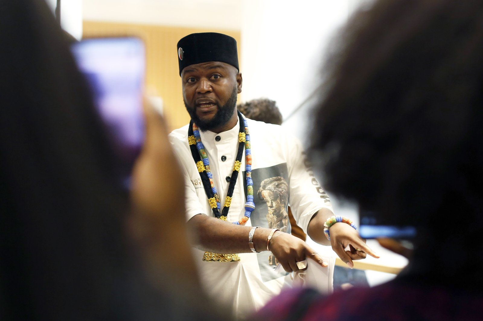 Congolese activist Mwazulu Diyabanza talk to the media at the Palais de Justice courthouse, in Paris, Sept. 30, 2020. (AP Photo)