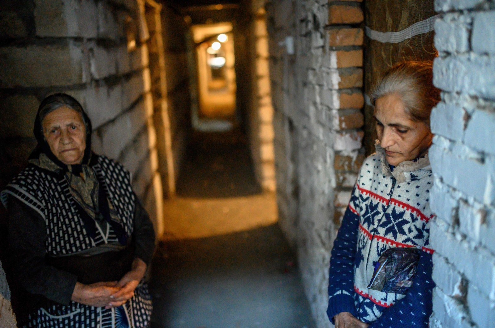 Women shelter from shelling in a basement of a building in the city of Terter, Azerbaijan, Oct. 13, 2020. (AFP Photo)