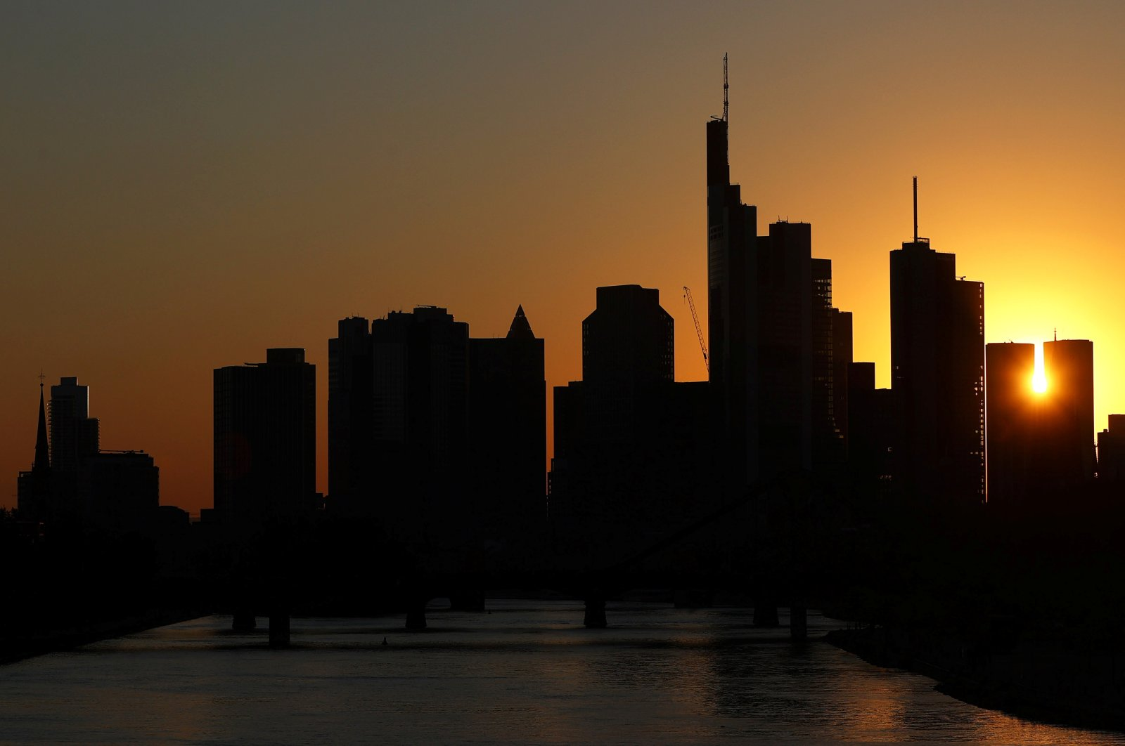 The skyline with its financial district is photographed during sunset in Frankfurt, Germany, April 22, 2020. (Reuters Photo)