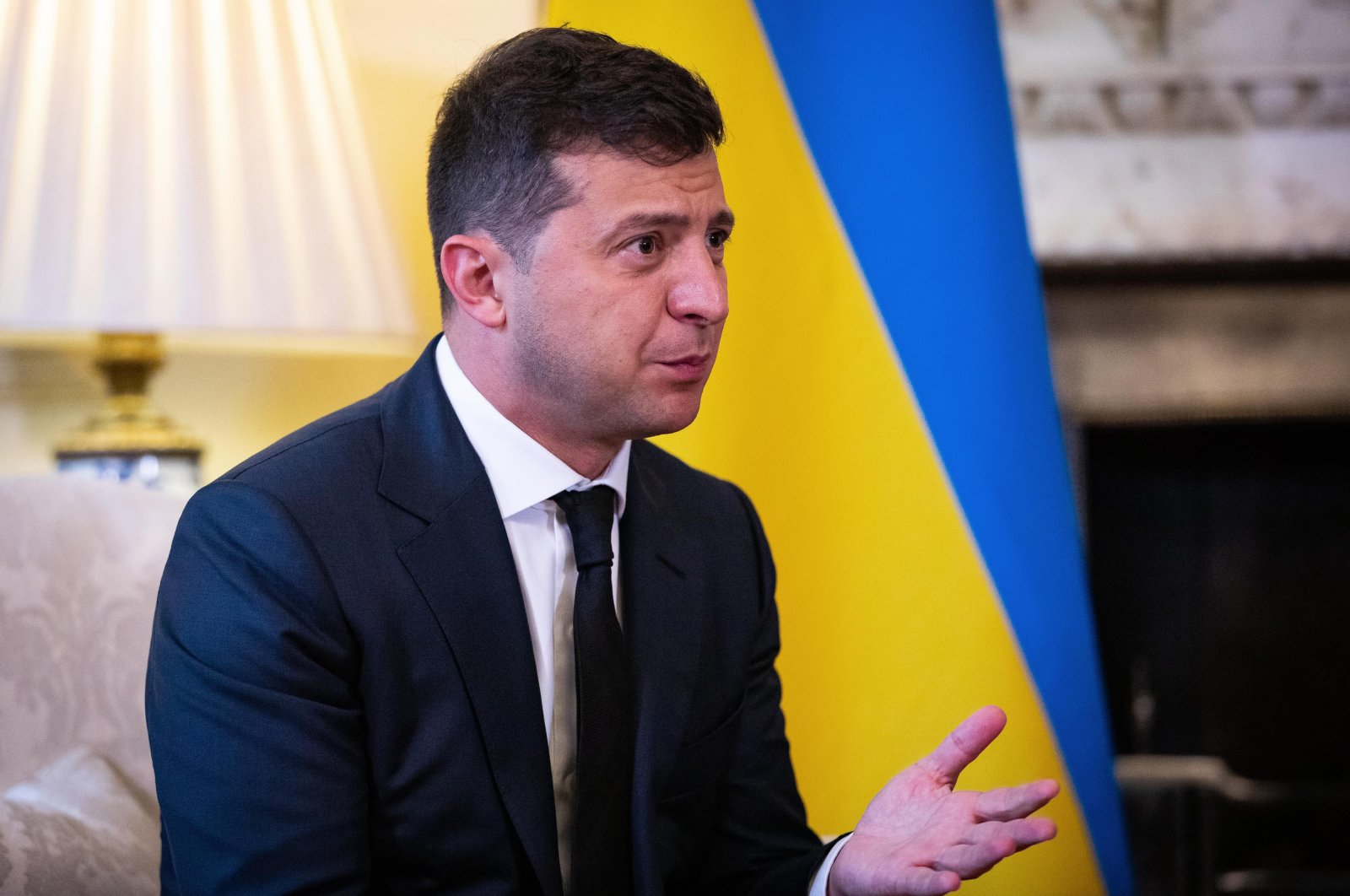 Ukraine's President Volodymyr Zelensky gestures during a meeting with Britain's Prime Minister Boris Johnson inside number 10 Downing Street, in central London on Oct. 8, 2020. (AFP Photo)