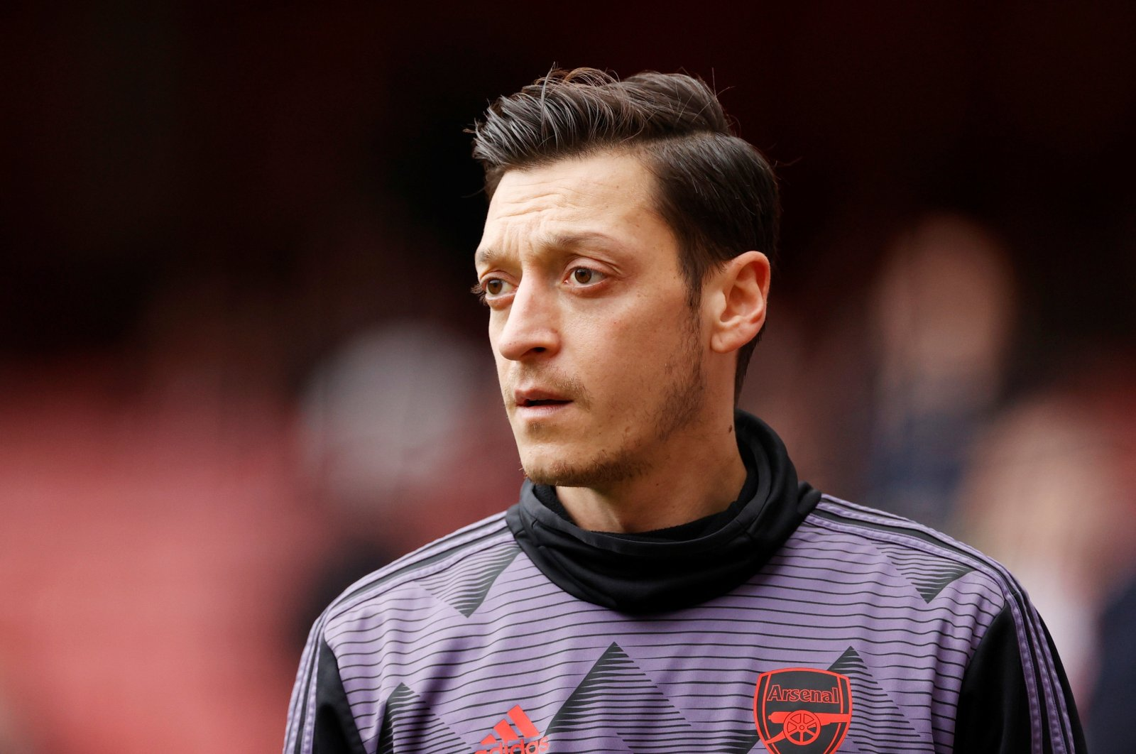 Arsenal's Mesut Özil during the warm up before the Premier League game between Arsenal and West Ham United, Emirates Stadium, London, March 7, 2020. (Reuters Photo)