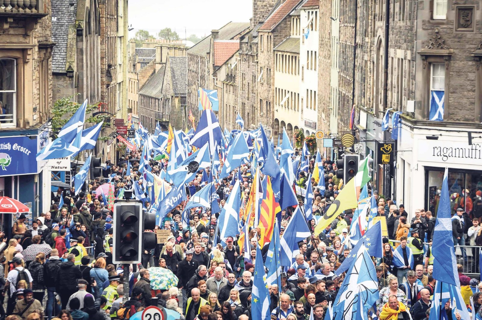 U.K. pro-independence activists wave Scottish saltire flags as they march from Holyrood to the Meadows, Edinburgh, Scottland, Oct. 5, 2019. (AFP)