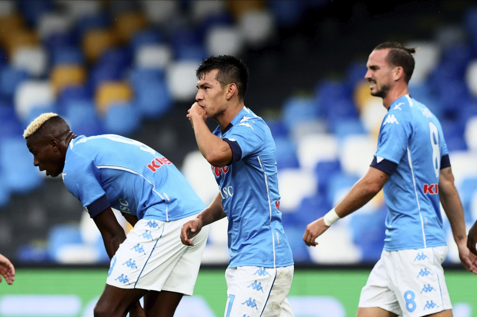 Napoli players celebrate a goal during a Serie A match against Genoa, in Naples, Italy, Sept. 27, 2020. (AP Photo)