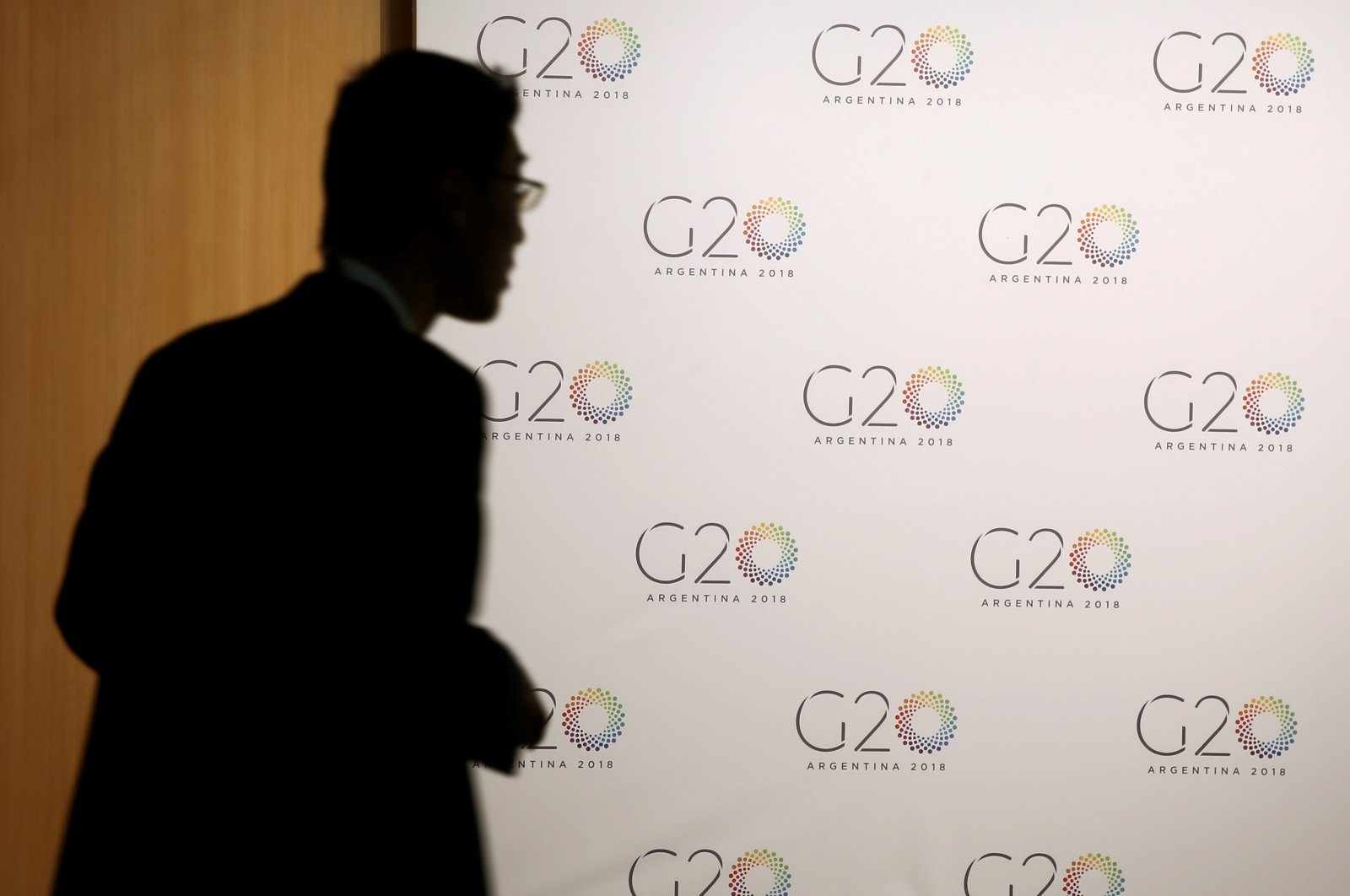 A man stands next to a board with the G-20 Meeting of Finance Minister's logo in Buenos Aires, Argentina, March 19, 2018. (Reuters Photo)