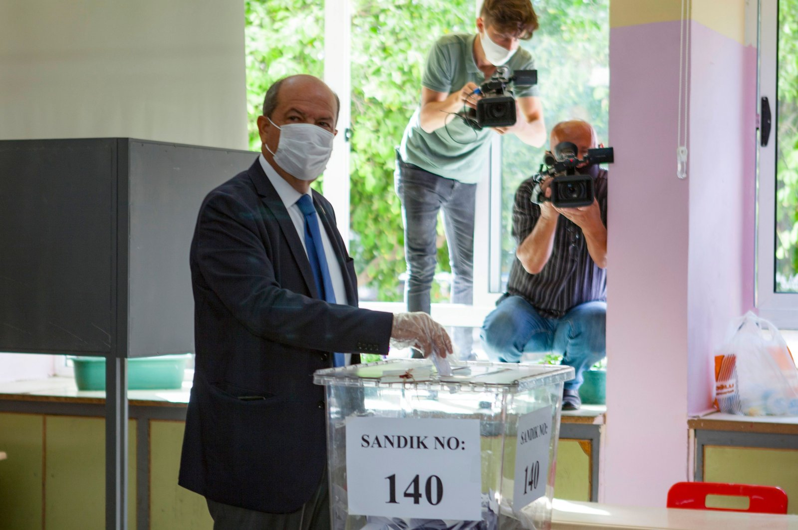 Turkish Cypriot Prime Minister Ersin Tatar casts his vote at a polling station in the northern part of Nicosia (Lefkoşa) during the presidential election, Oct. 11, 2020. (AFP Photo)