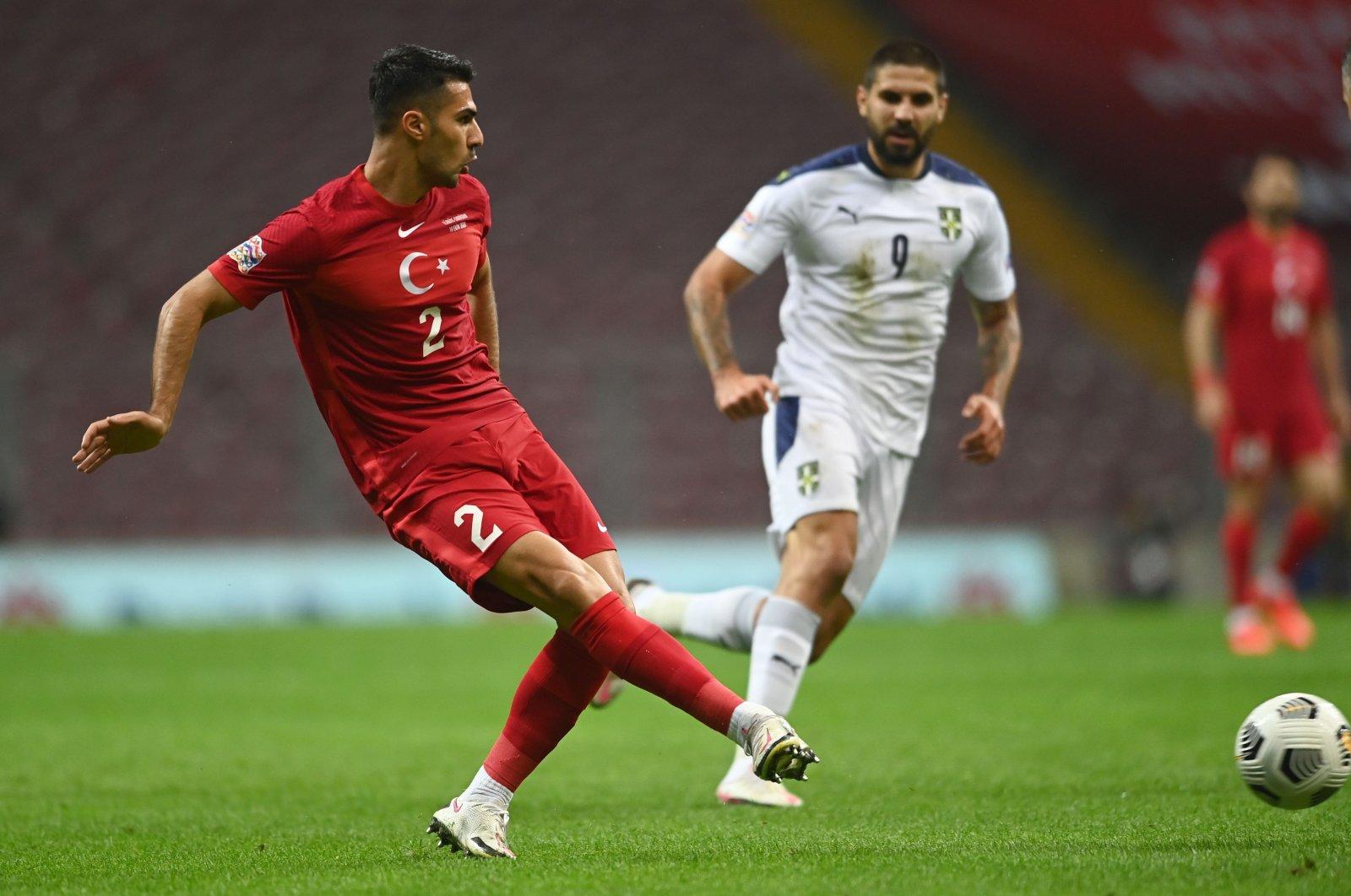 Serbia's Aleksandar Mitrovic (R) tries to intercept as Turkey's Zeki Çelik passes the ball during a UEFA Nations Leage Match against Serbia, in Istanbul, Turkey, Oct. 14, 2020. (AFP Photo)