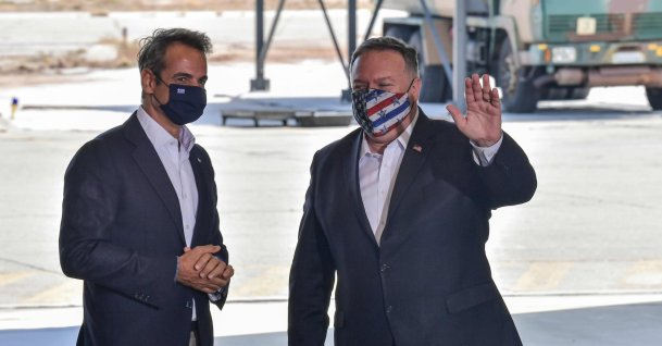U.S. Secretary of State Mike Pompeo (R) waves next to Greek Prime Minister Kyriakos Mitsotakis during his visit to the Naval Support Activity base in Souda, the foremost U.S. naval facility in the Eastern Mediterranean on the Greek island of Crete. (AFP Photo)