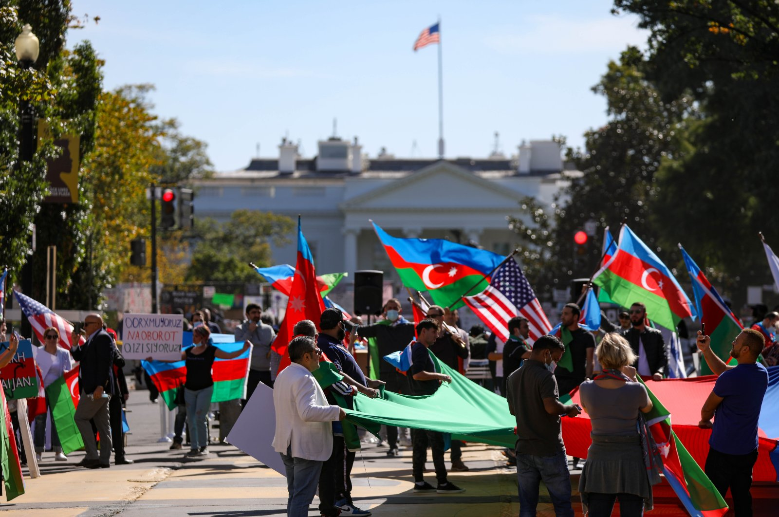 Demonstrators carrying Azerbaijani and Turkish flags gather in front of the White House in order to show their support for Azerbaijan, Washington, D.C., U.S., Oct. 15, 2020. (AA Photo)