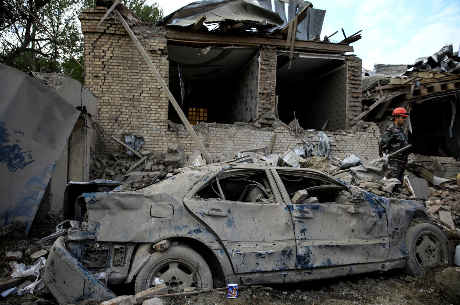 A damaged car is seen at the blast site hit by a rocket during the fighting over the breakaway region of Nagorno-Karabakh, in the city of Ganja, Azerbaijan, Oct. 11, 2020. (REUTERS)