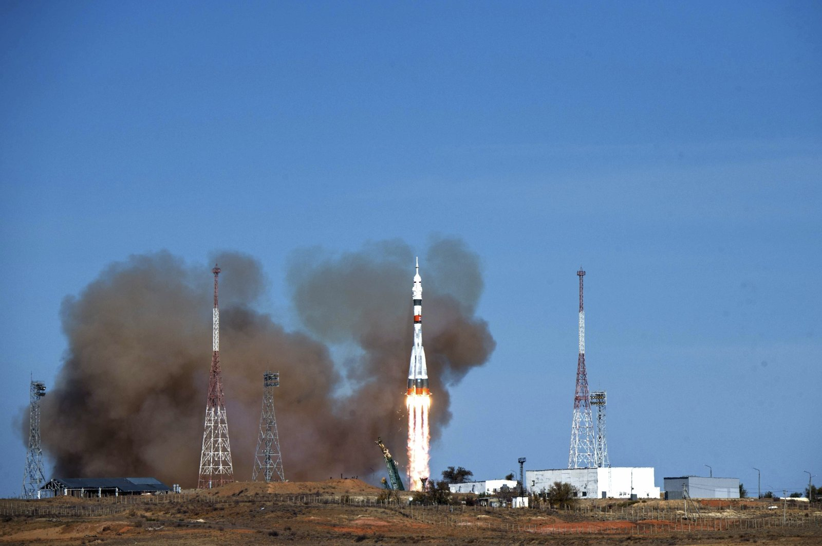 The Soyuz-2.1a rocket booster with the Soyuz MS-17 space ship carrying a new crew to the International Space Station (ISS) blasts off at the Russian leased Baikonur cosmodrome, Kazakhstan, Oct. 14, 2020, in this handout photo released by Roscosmos Space Agency. (AP Photo)
